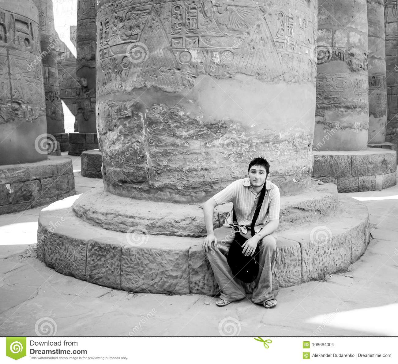 Prime Young Tourist Sat At The Base Of An Ancient Egyptian Pillar Cjindustries Chair Design For Home Cjindustriesco