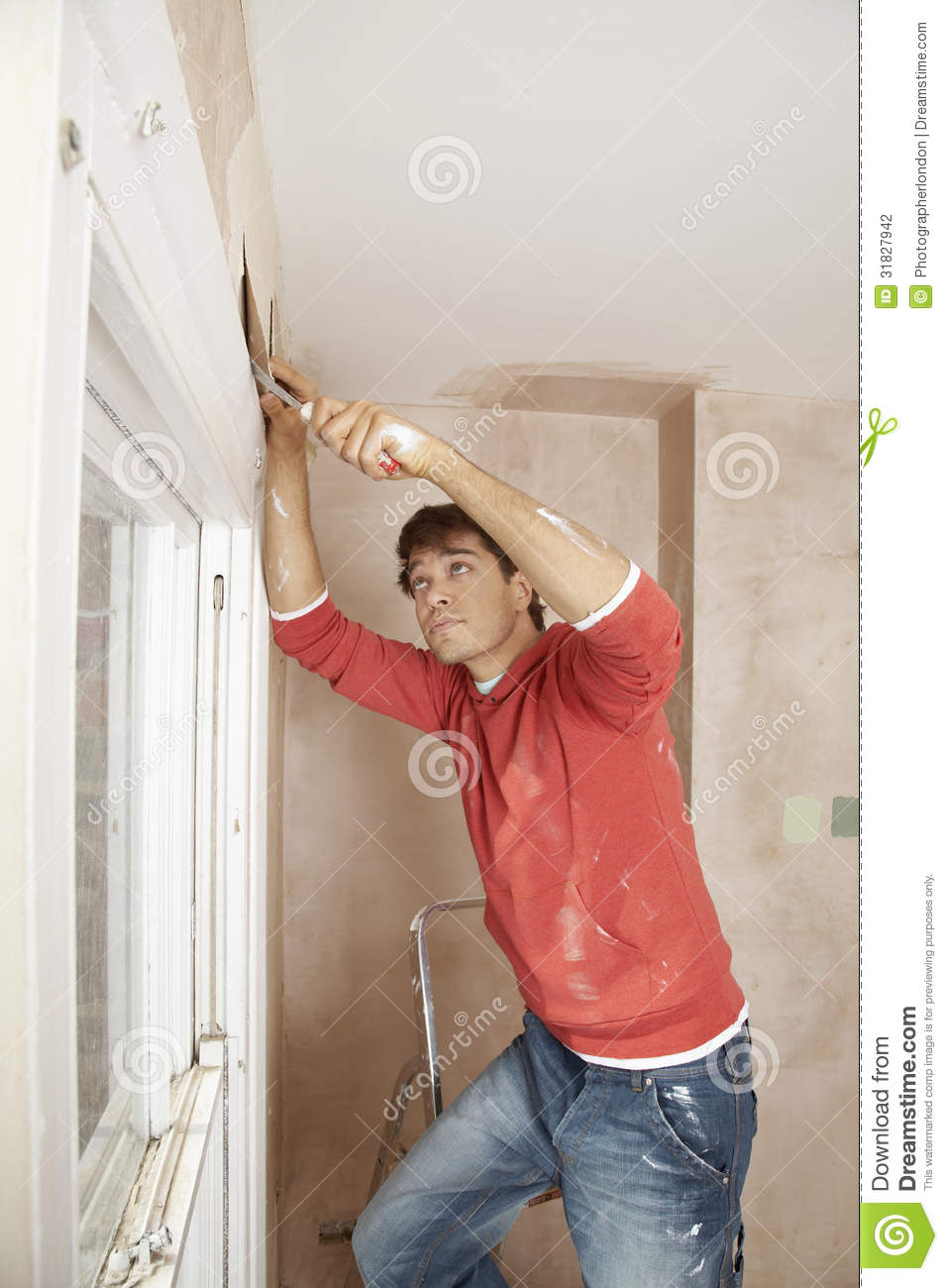 Man Scraping Paint Off Wall Stock Photography Image