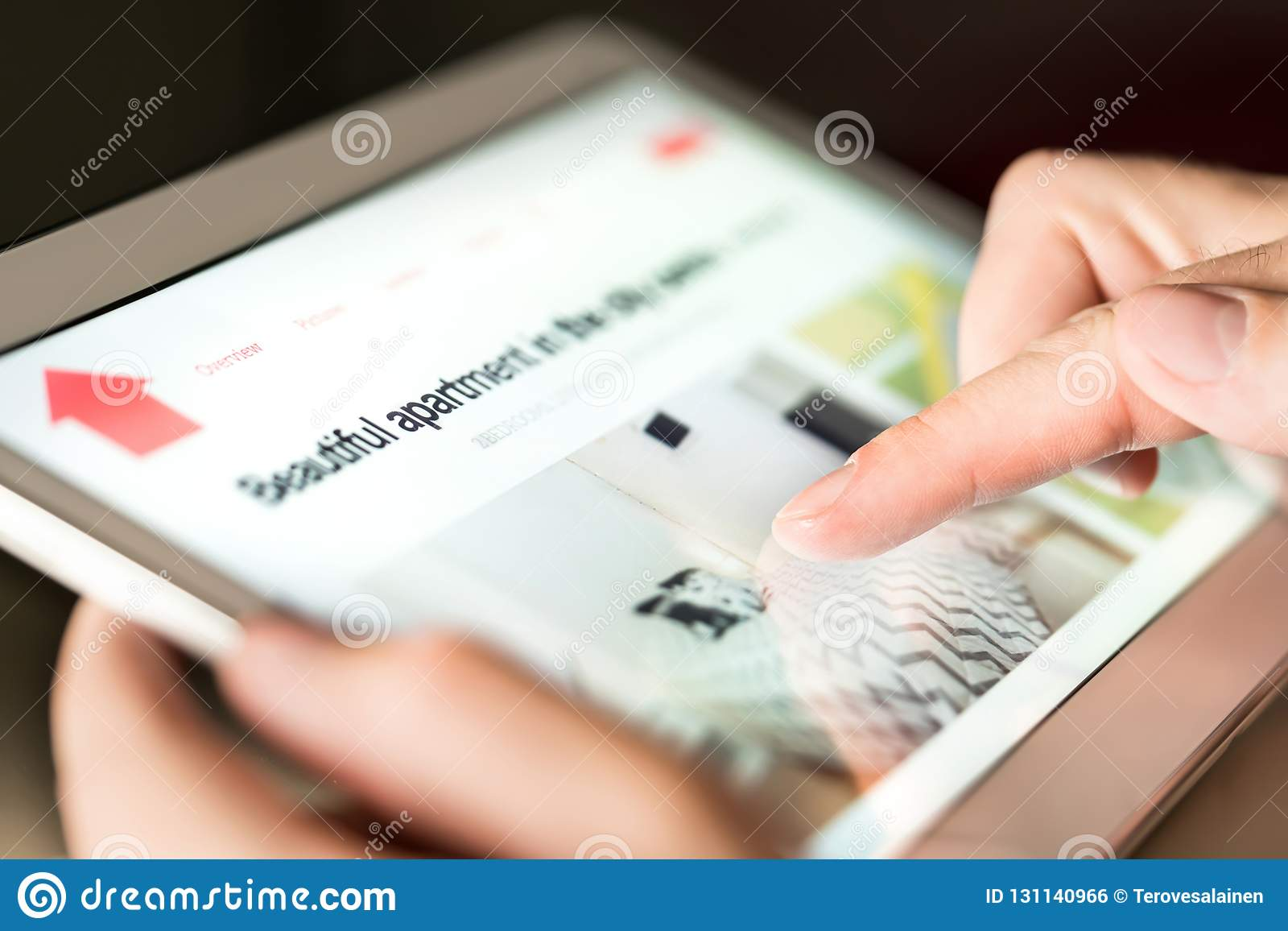Man searching holiday home, vacation apartment or property for rent online with tablet.