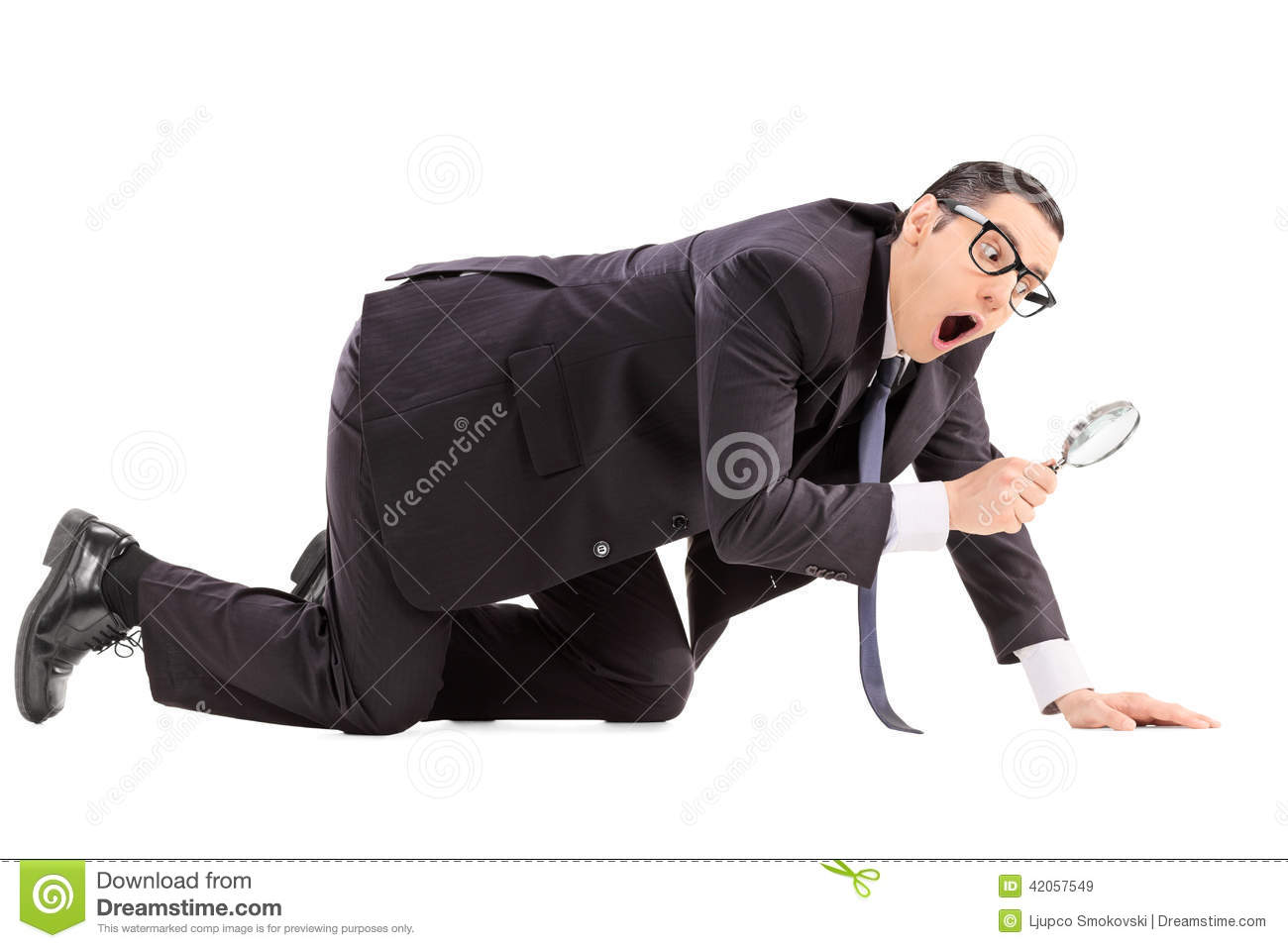 Man Searching For Something With A Magnifier Stock Image
