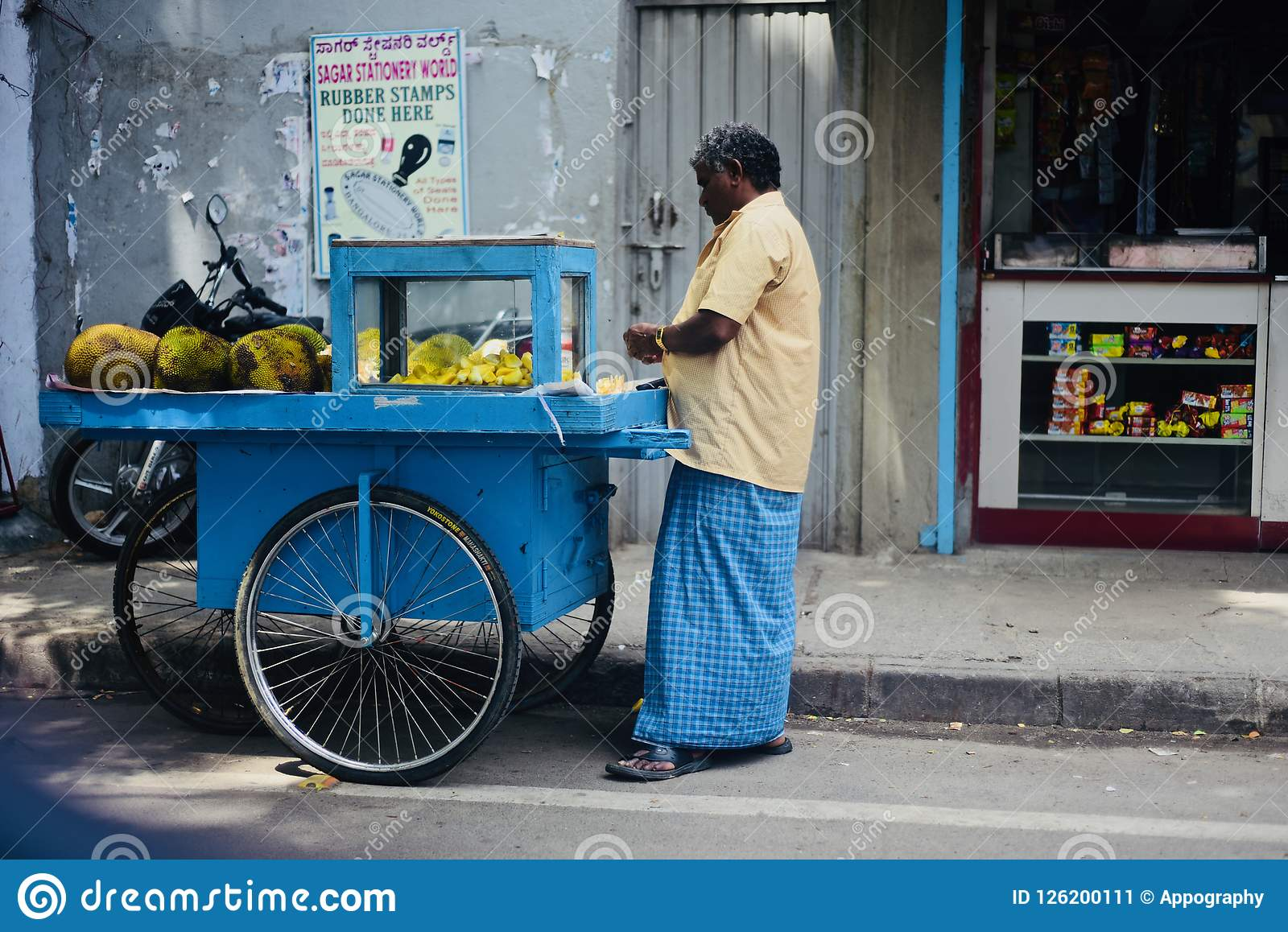 Man selling jackfruits in the street of Bangalore India