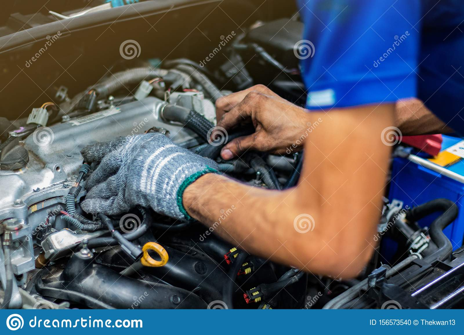 Man service checking the car engine