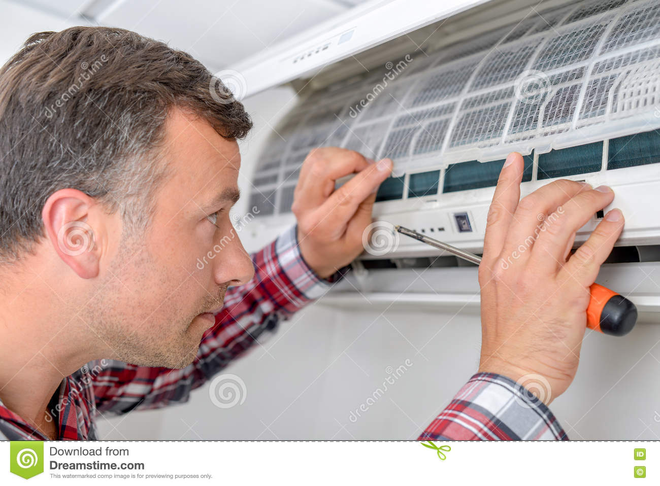 Man Setting Up An Air Conditioning Unit Stock Image