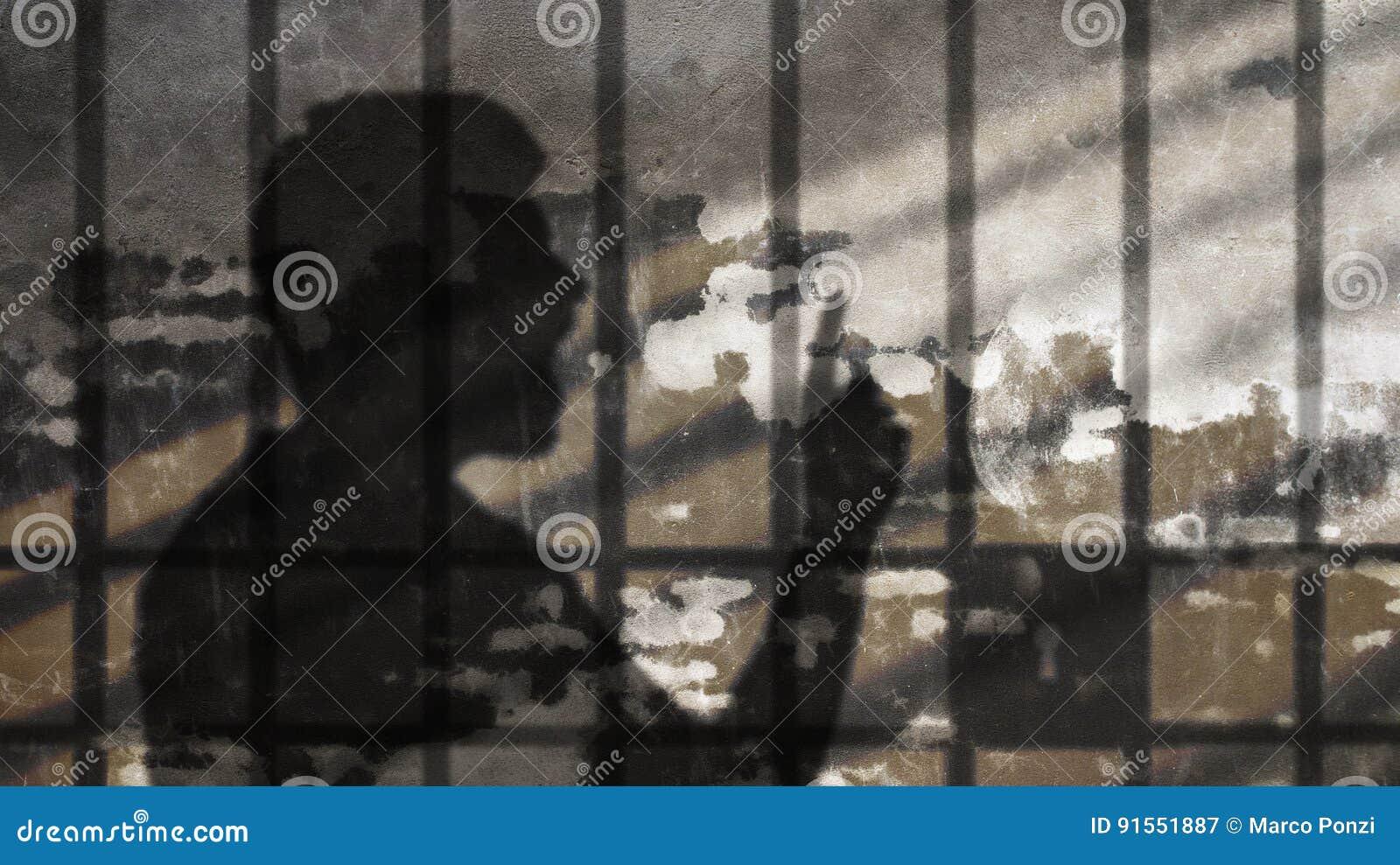 Man Shadow Talking Under Jail Bars.