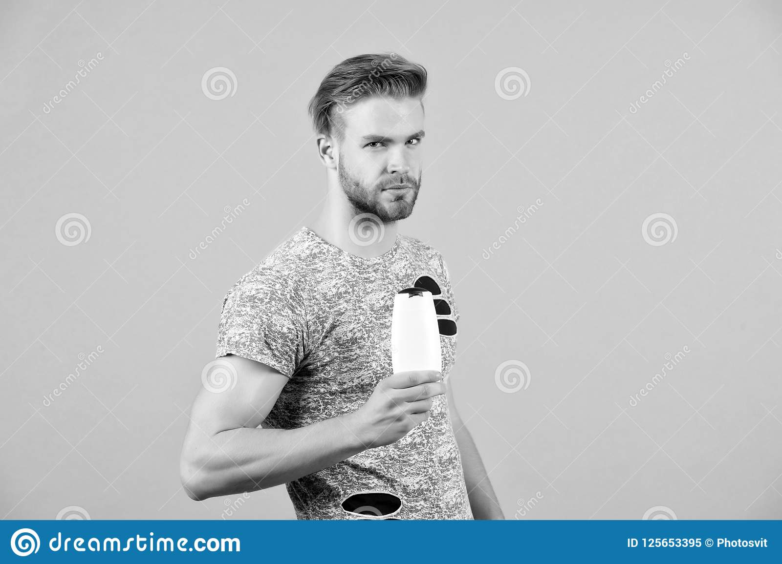 Man With Shampoo Or Gel Bottle In Hand Macho With Stylish Hair
