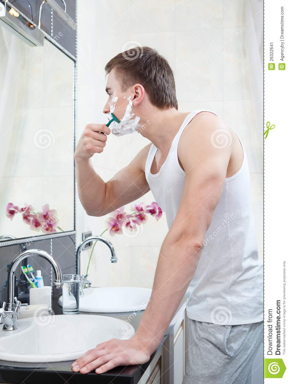 man shaves in the bathroom - In The Bathroom