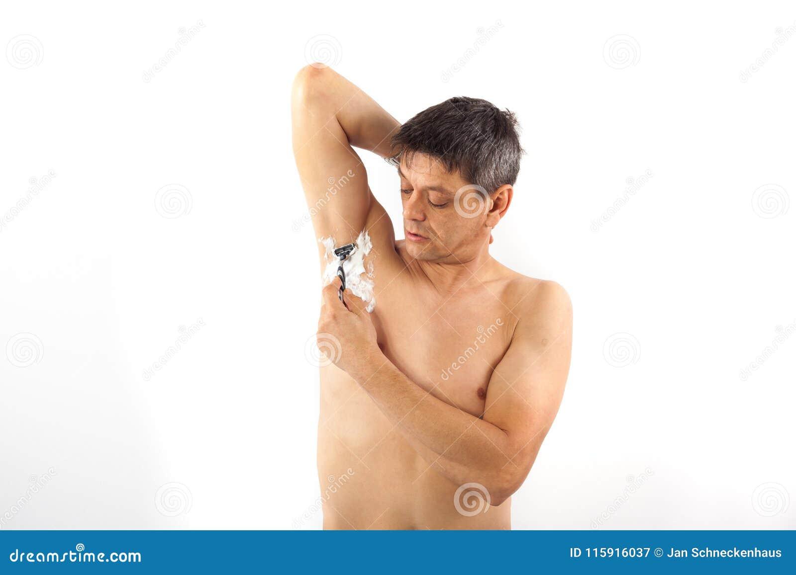 Man shaves his armpit hair