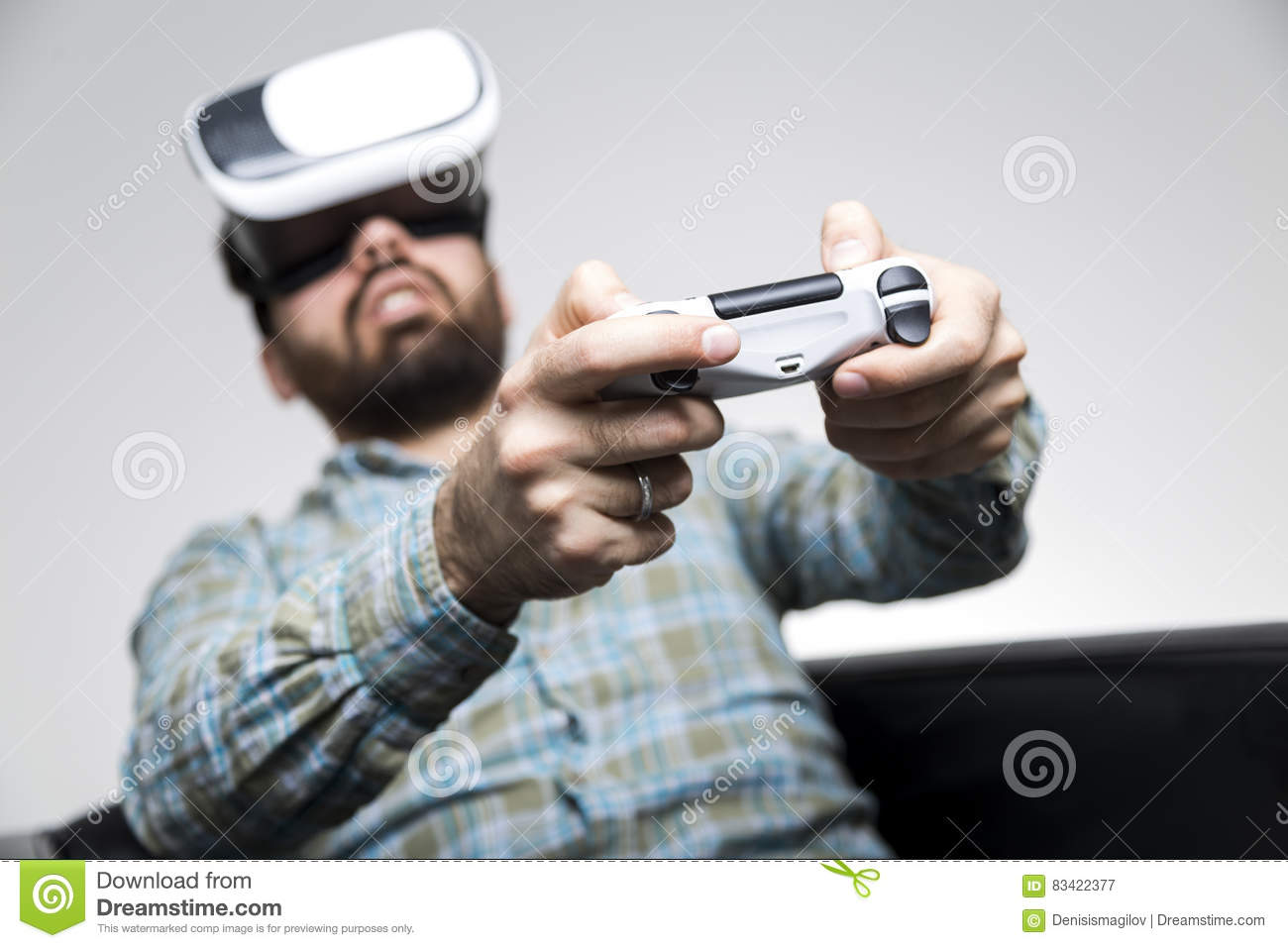 Man in shirt playing vr game with controller