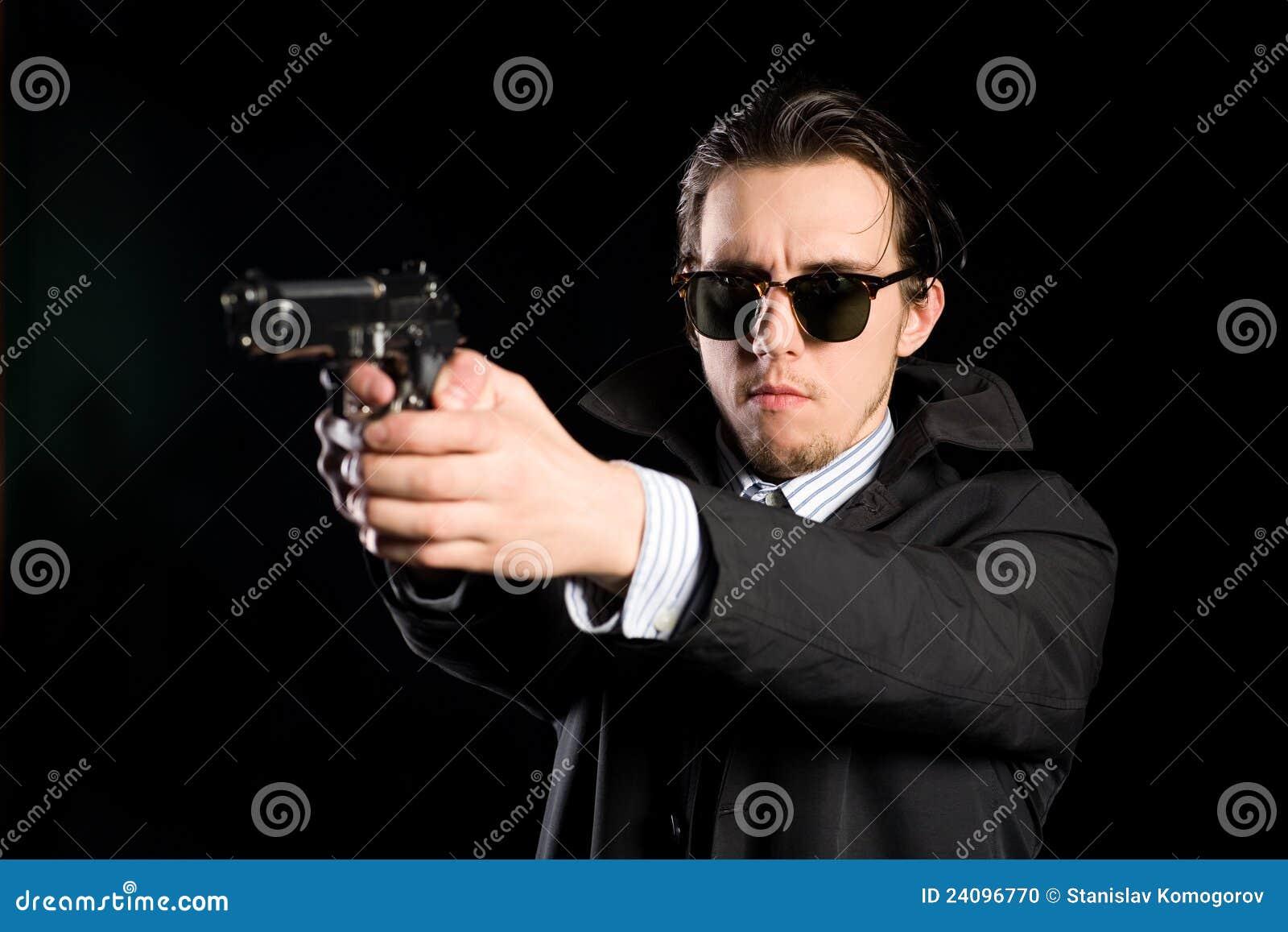 Man Shooting A Gun Stock Photo Image 24096770