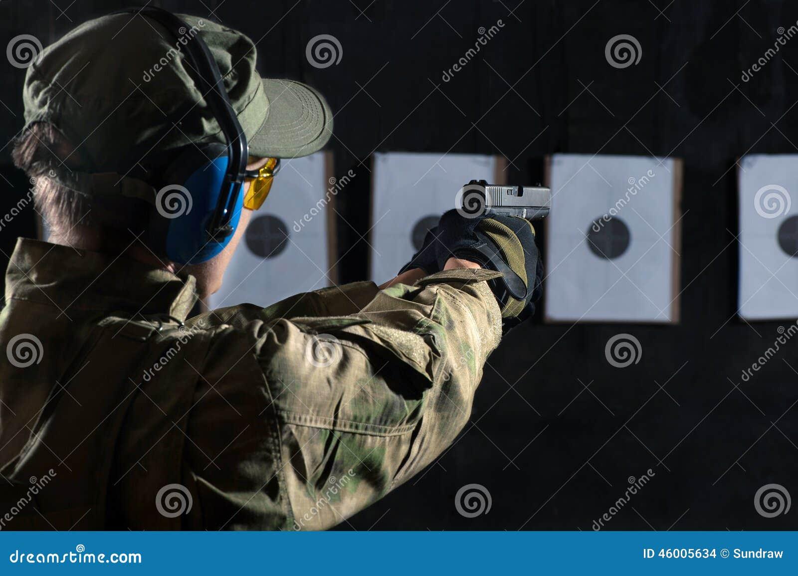 man shooting stock photo image 46005634