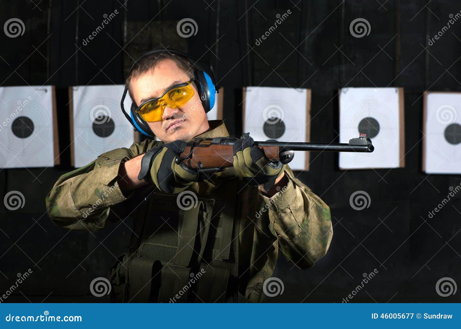 man shooting stock photo image 46005677