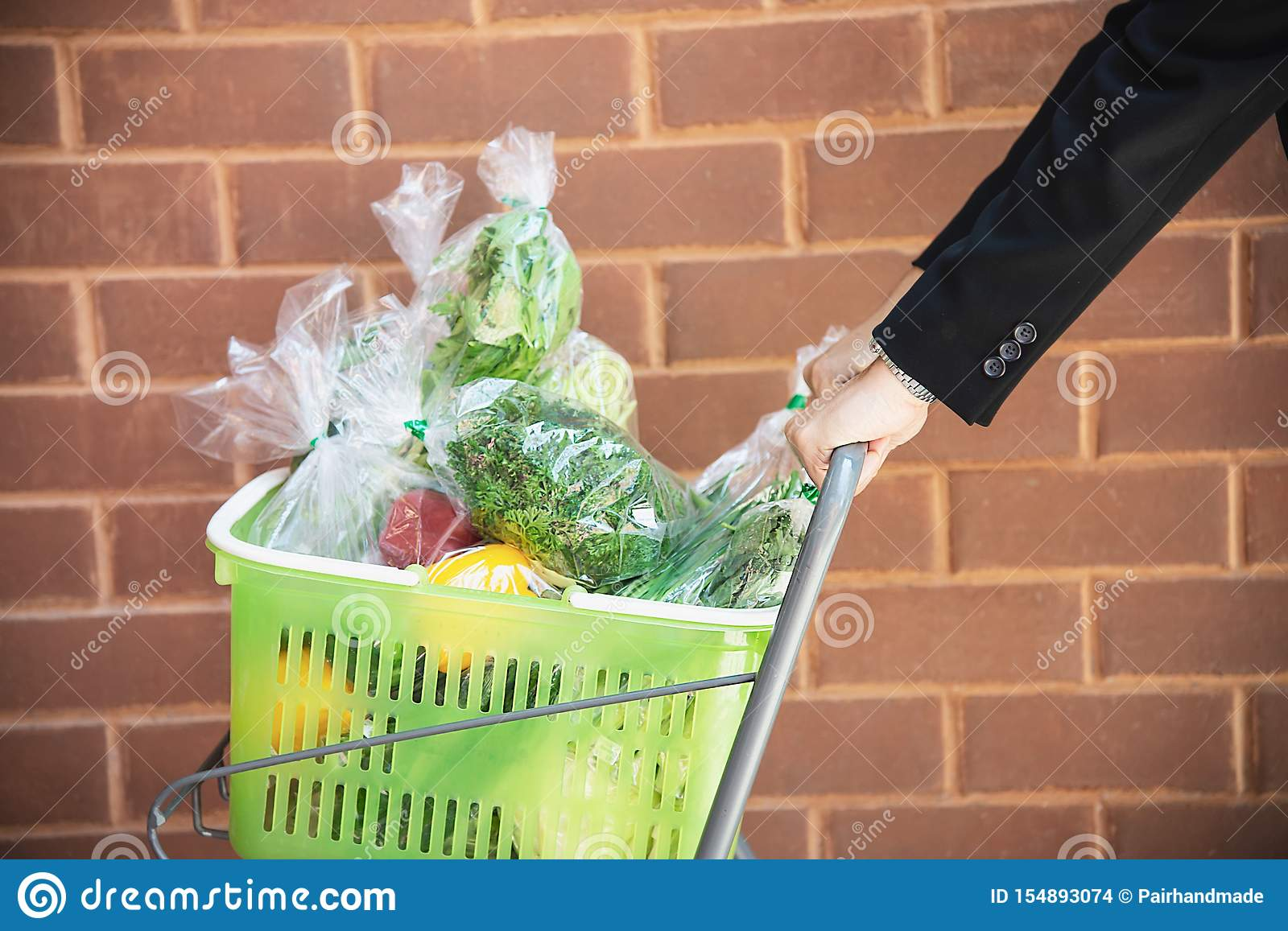 Man is shopping fresh vegetable in supermarket store