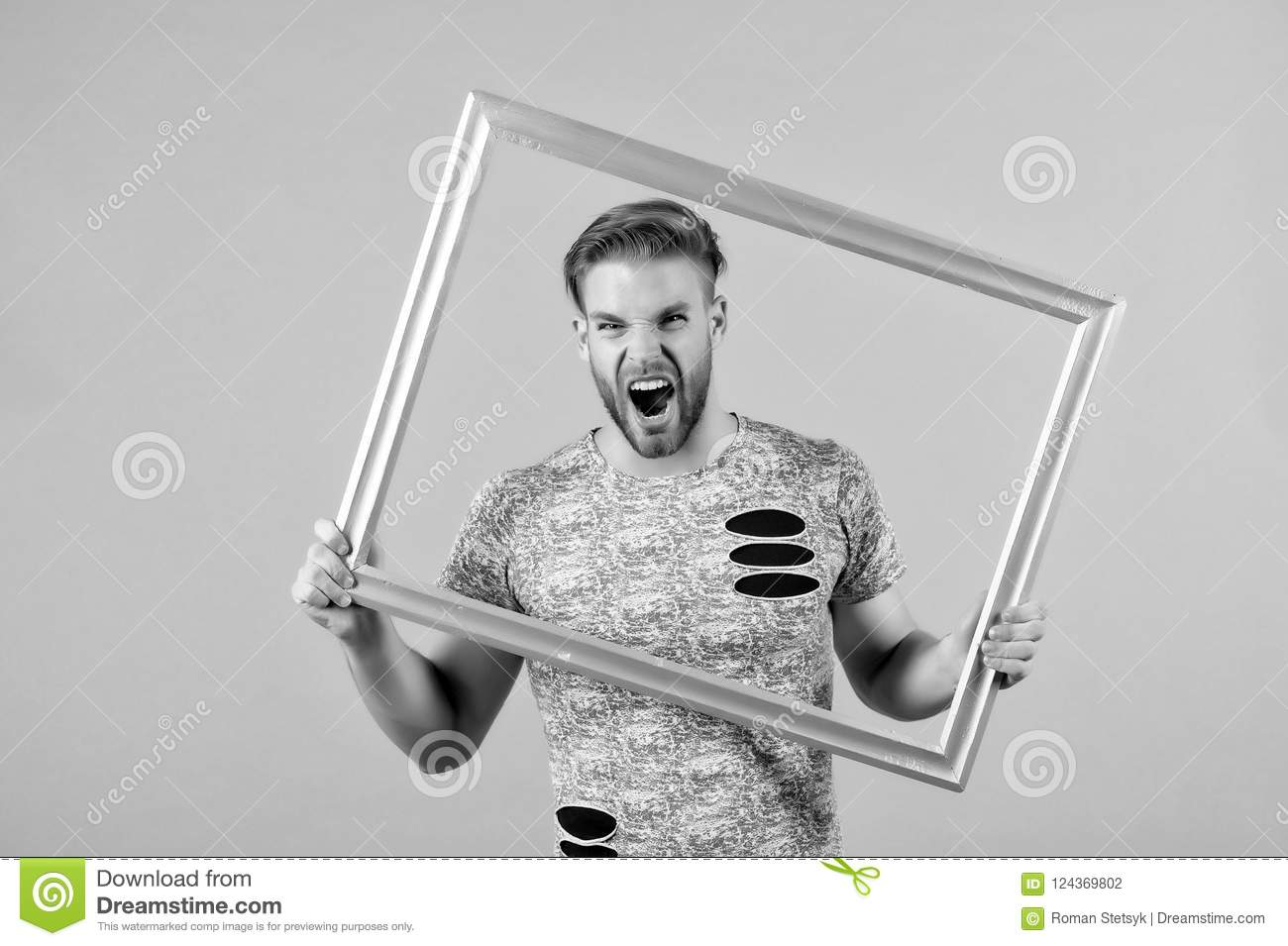 Man Shout With Picture Frame On Grey Background Angry Macho With