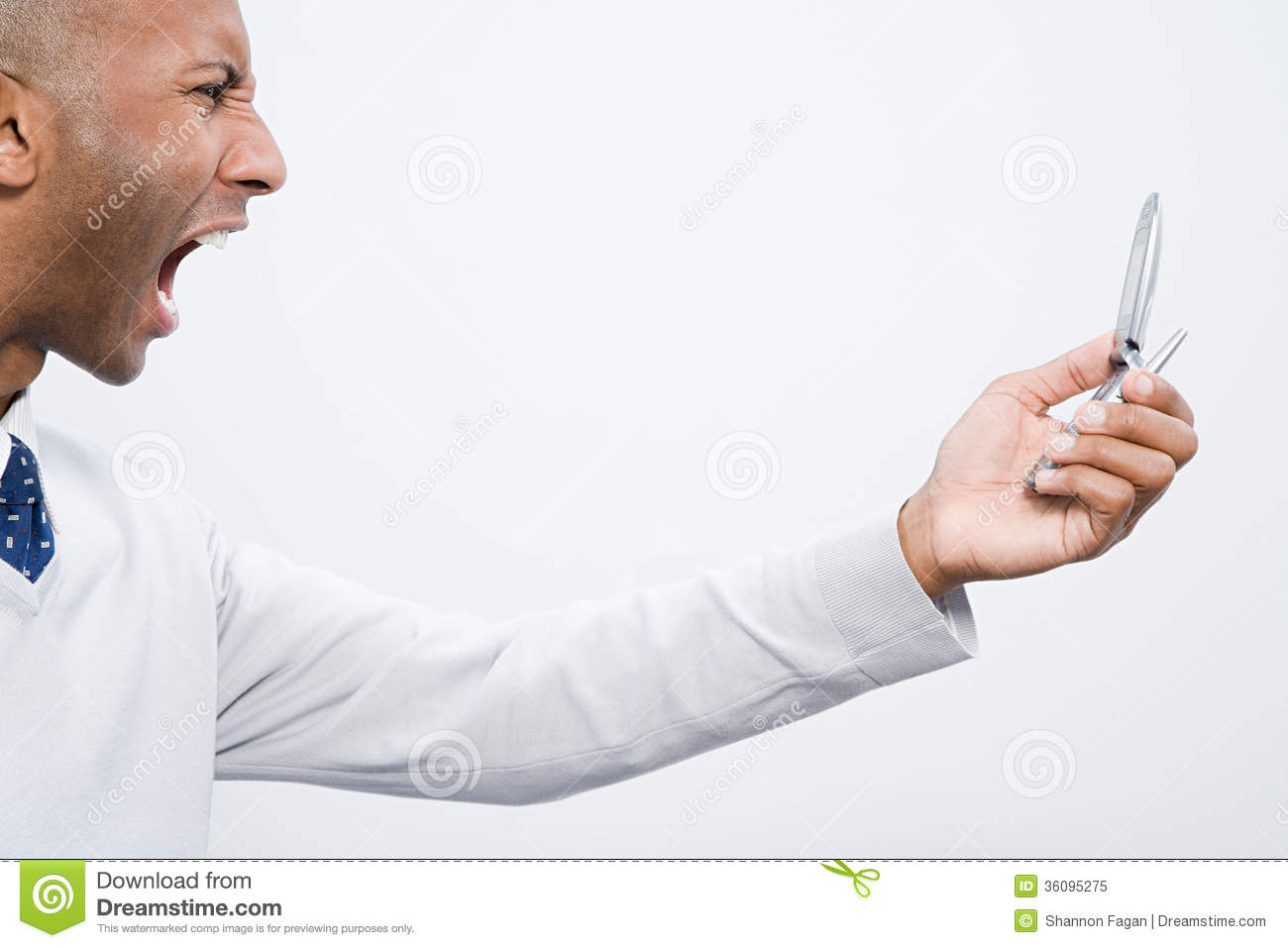 A man shouting at a cell phone