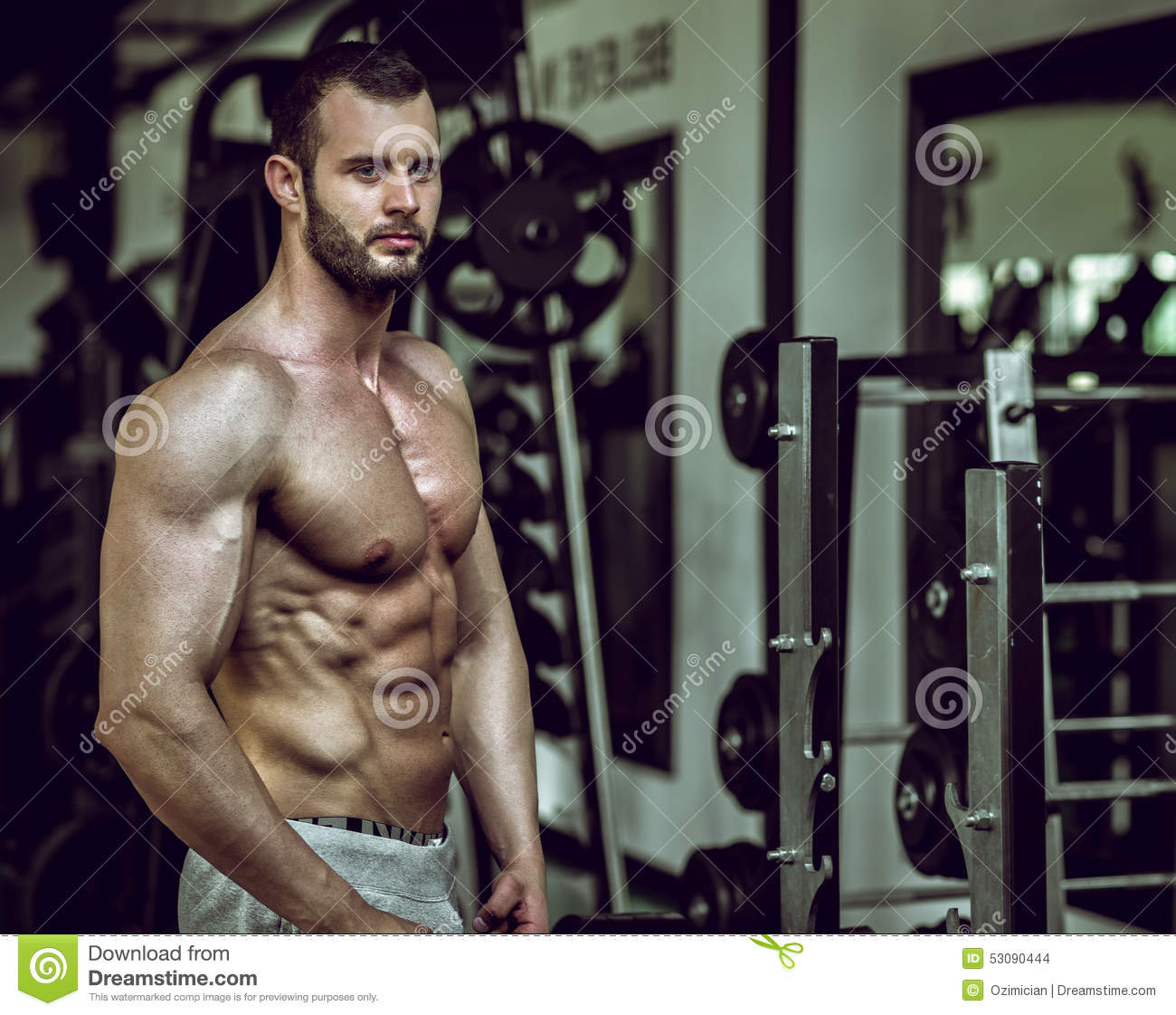 Man showing abs in gym