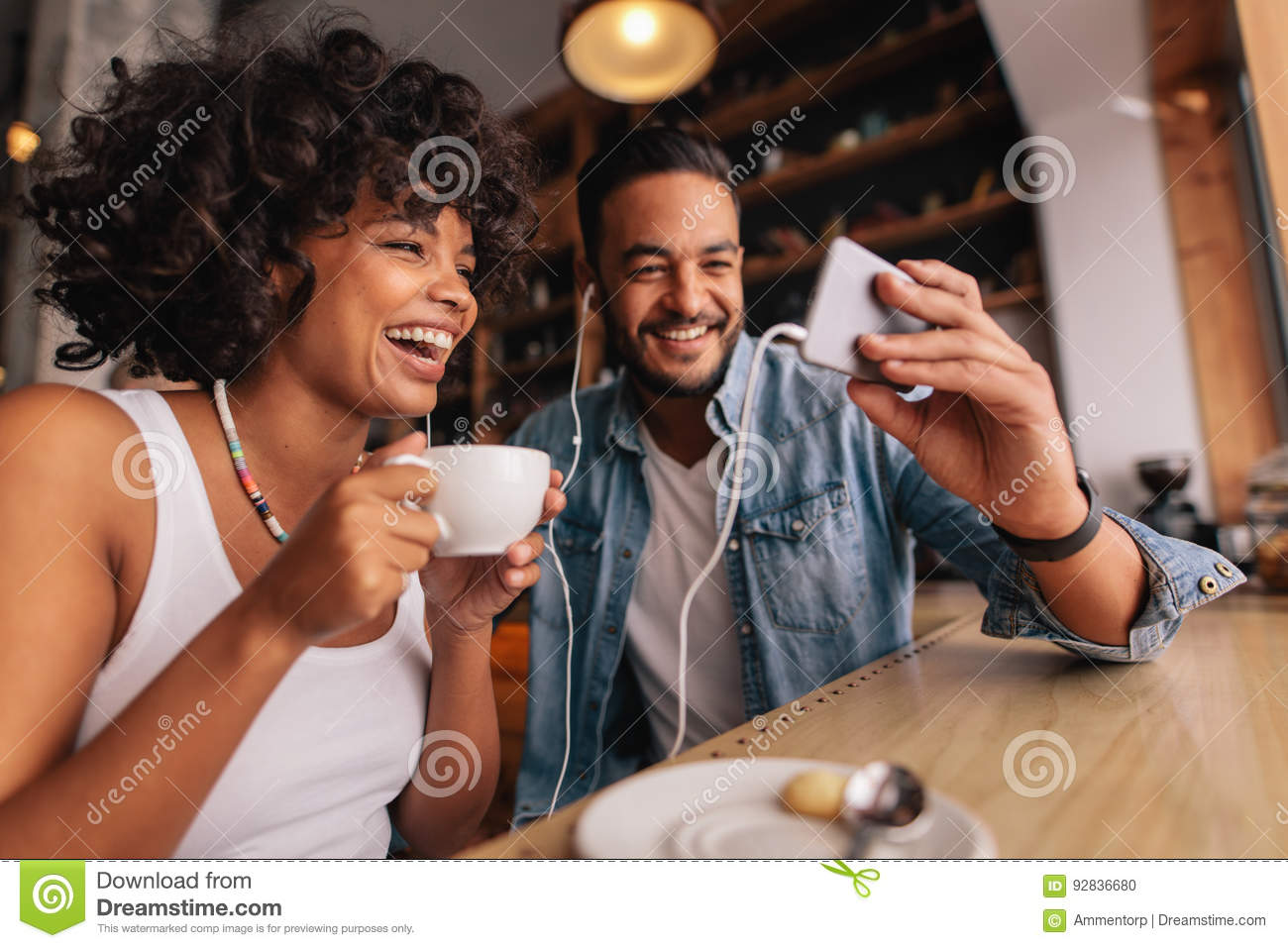 Man showing something on cellphone to his girlfriend