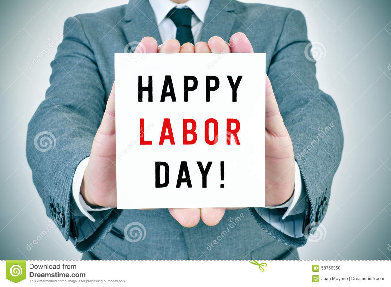 Man shows a signboard with the text happy labor day