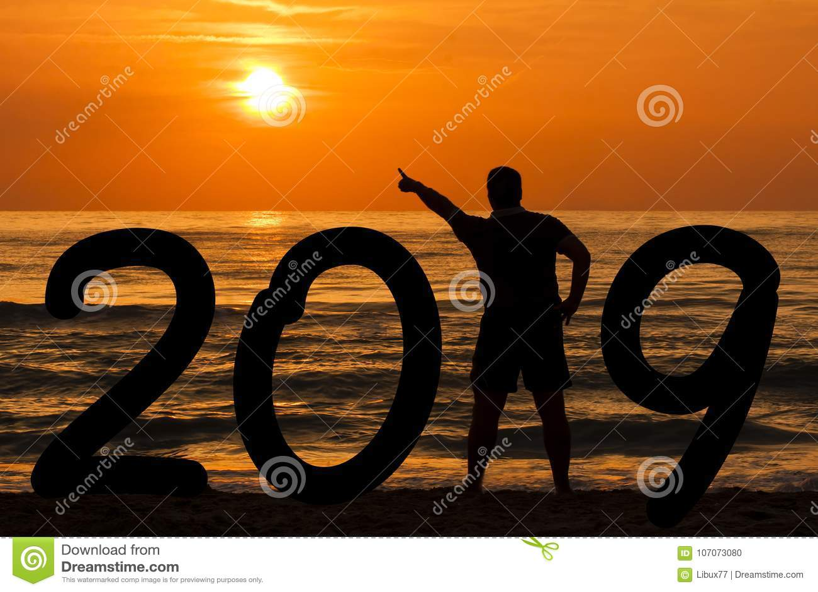 Man Silhouette year 2019 at sunrise at sea
