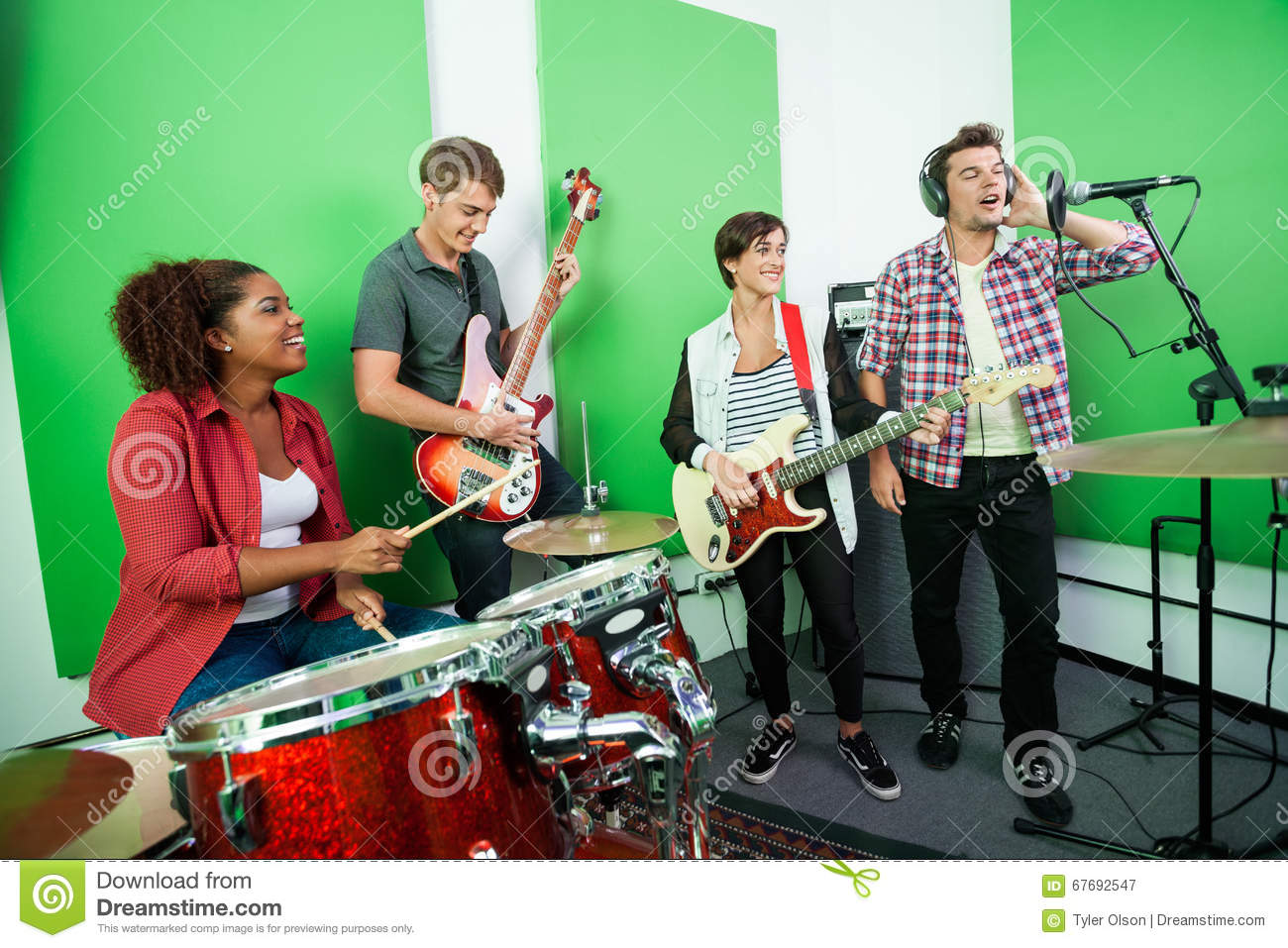 Man Singing While Colleagues Playing Musical Instrument