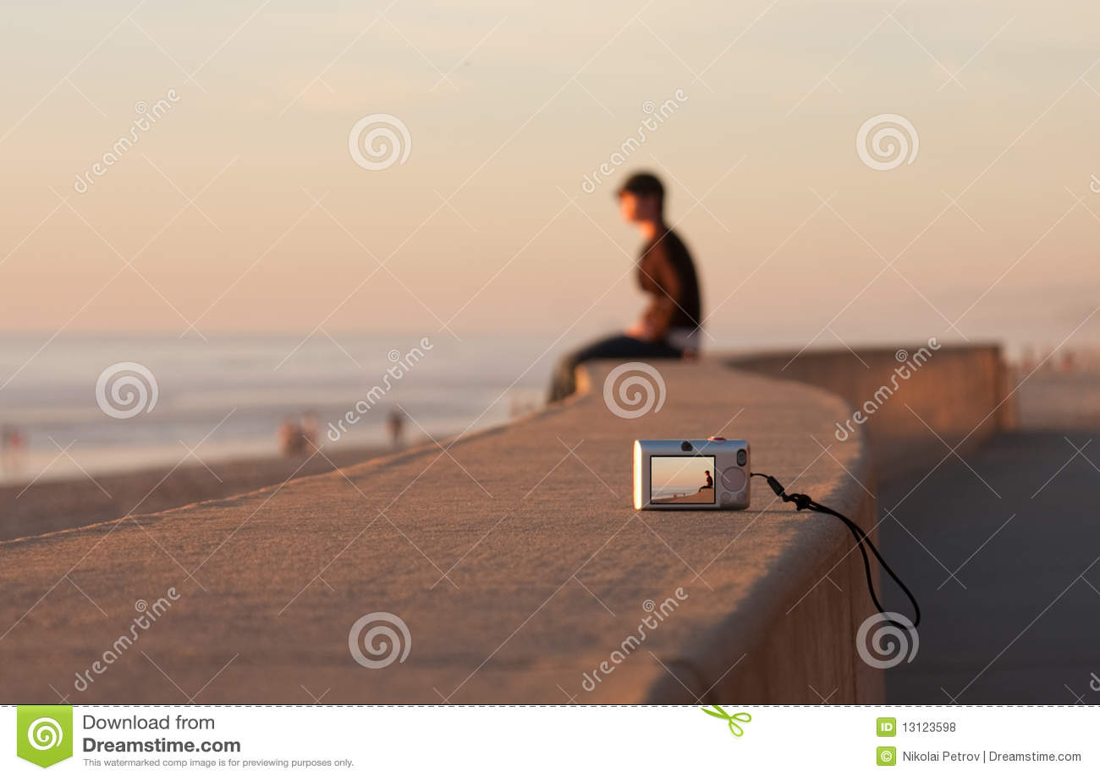 Man Sitting Alone Sunset Beach And Camera Stock Photo - Image ...