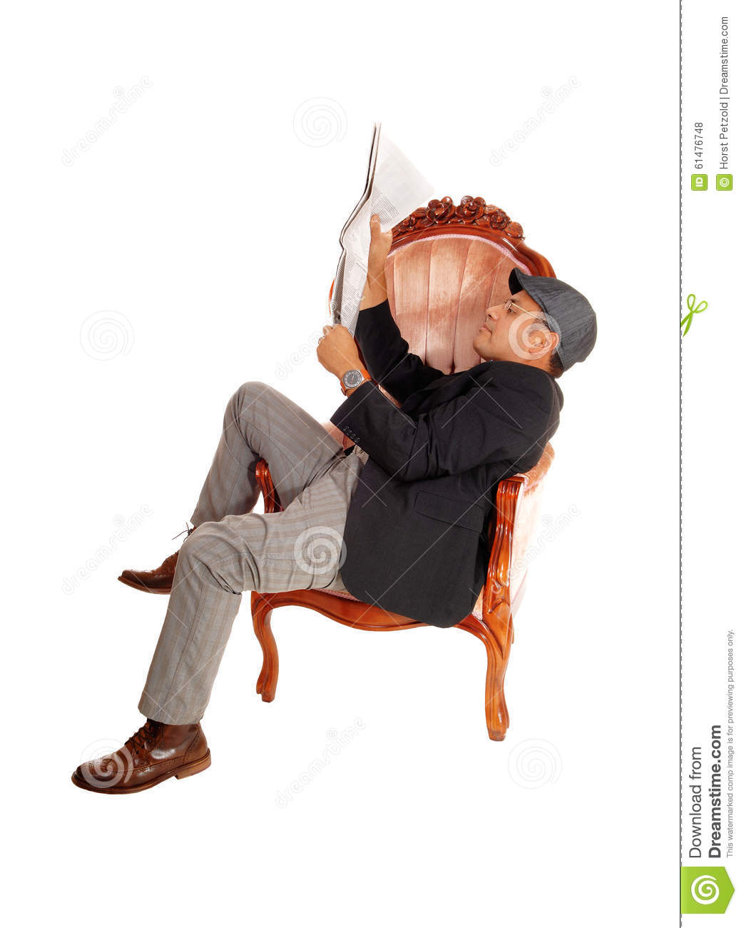 Man sitting in armchair reading paper stock photo image for Sitting in armchair