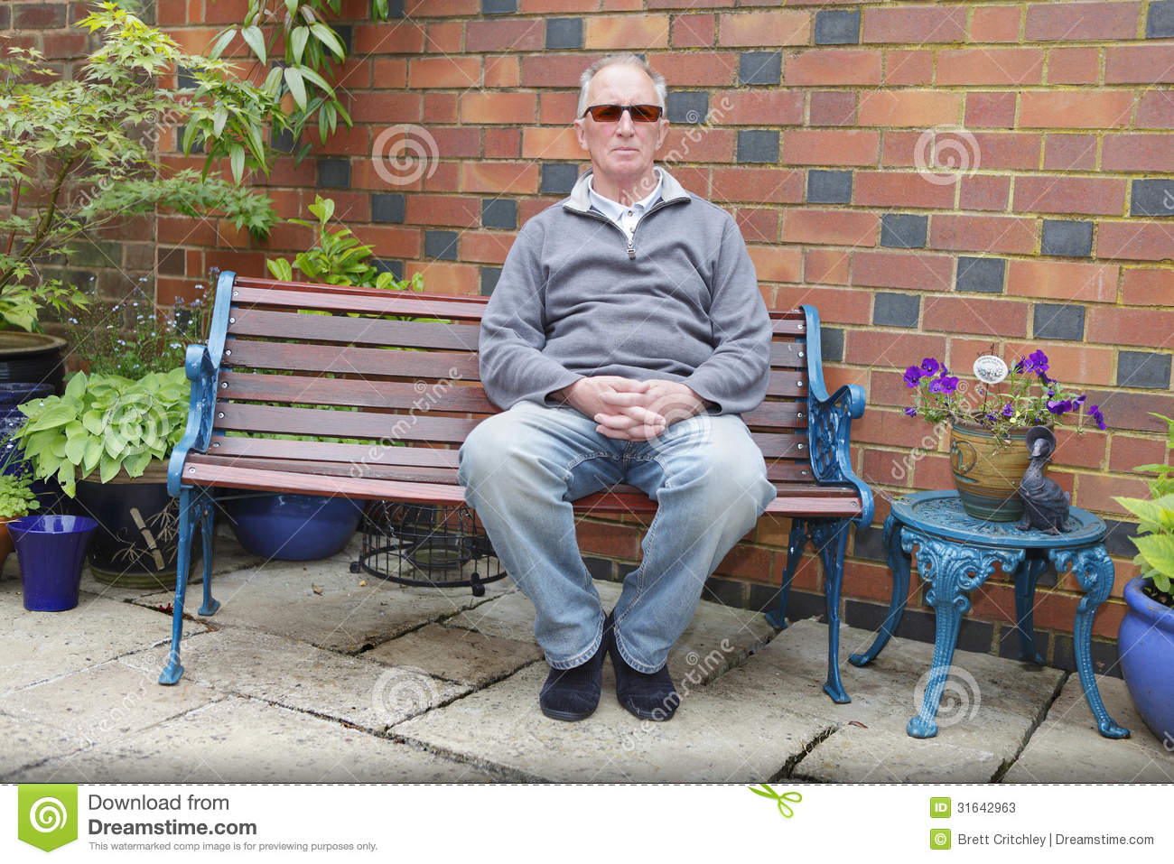 Man Sitting On A Bench Stock Photos Image 31642963