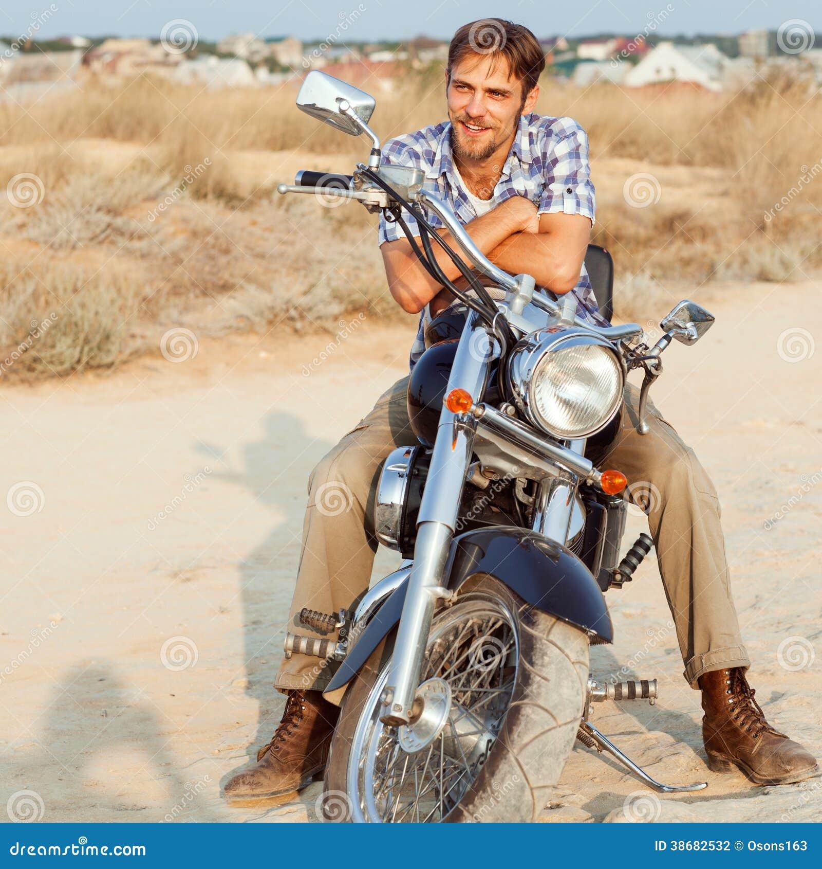 A man is sitting on bike