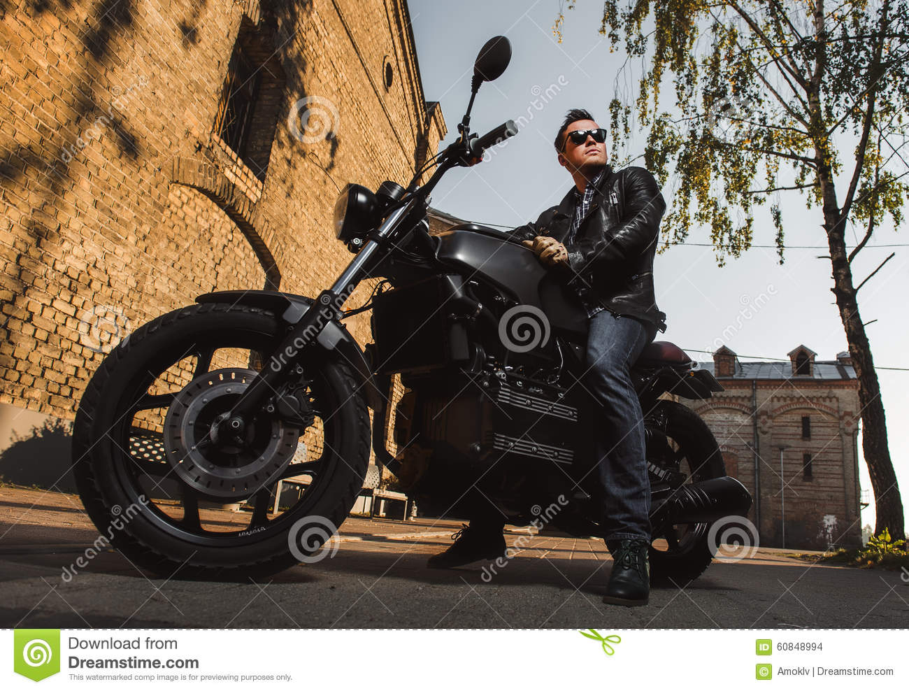 Man sitting on a cafe-racer motorcycle