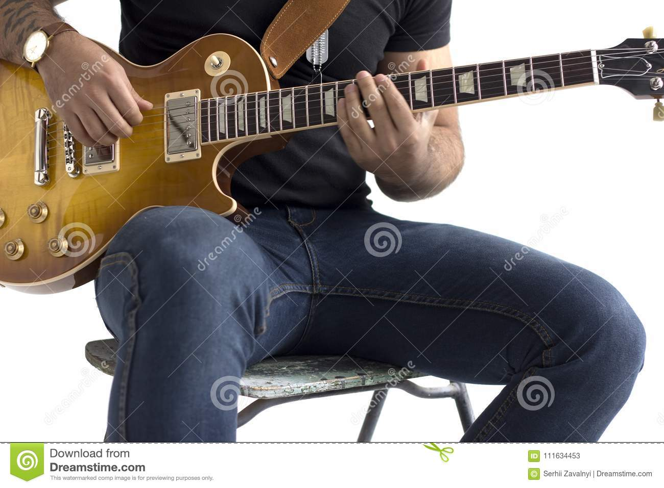 A man is sitting on a chair and playing an electric guitar on a white background.