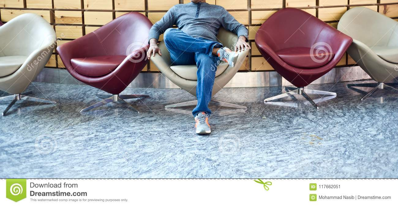 Download Young Man Sitting On A Stylish Chair Unique Photo Stock Image - Image of young, image: 117662051