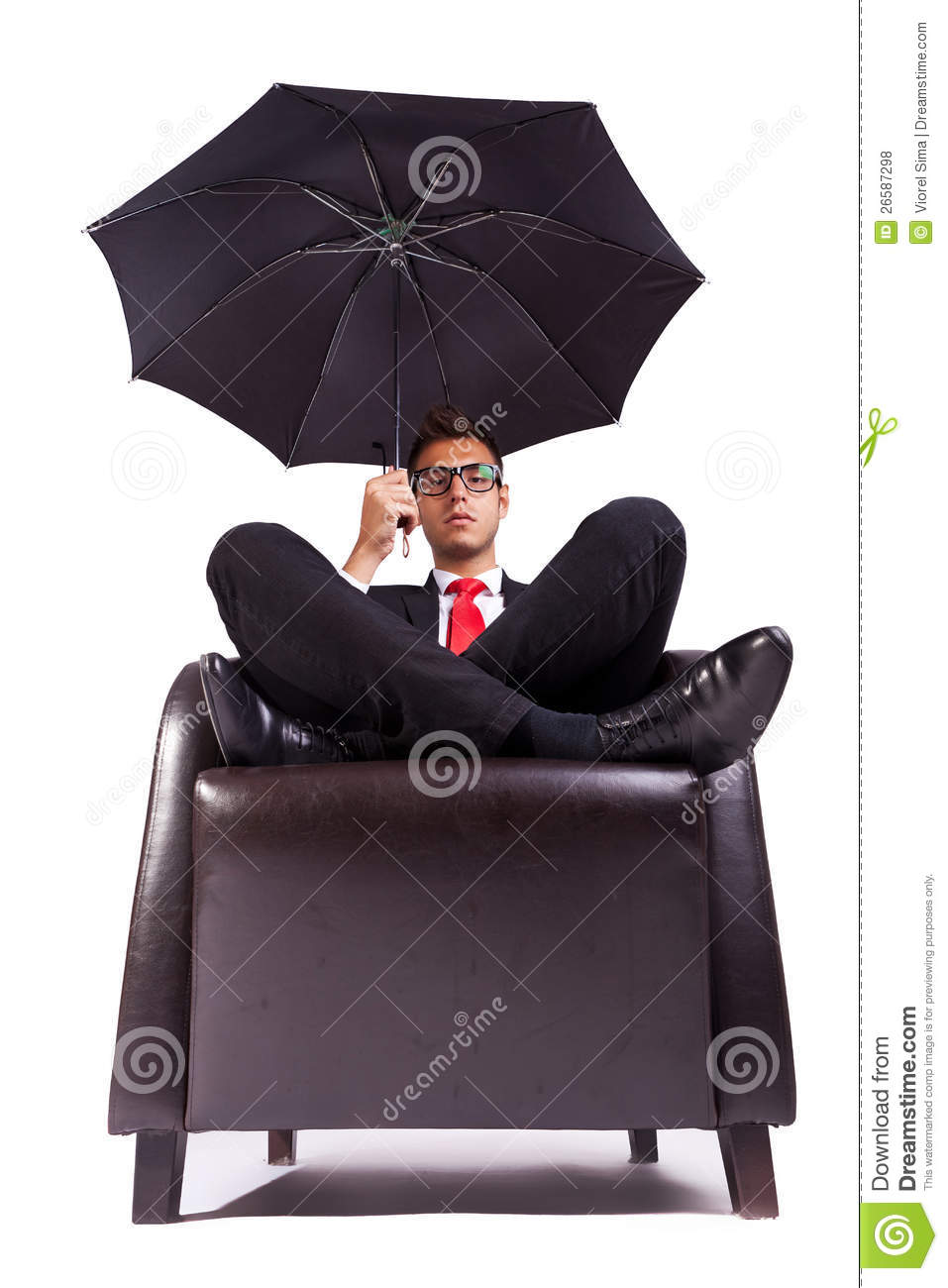 Man sitting in comfortable armchair with umbrella stock for Sitting in armchair