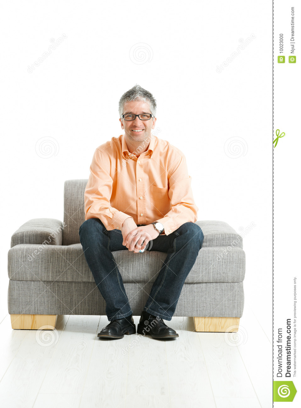 Man Sitting On Couch Stock Photo - Image: 10023000