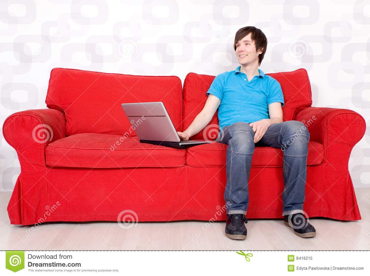 man sitting on couch with laptop stock image image of. Black Bedroom Furniture Sets. Home Design Ideas
