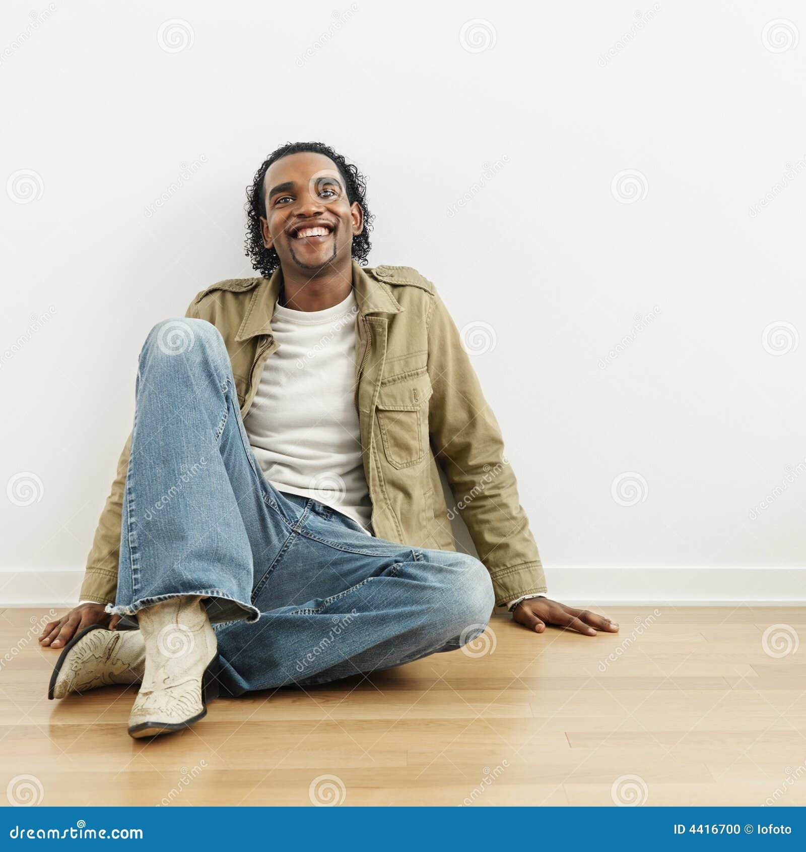 Man Sitting On Floor Stock Photo Image 4416700