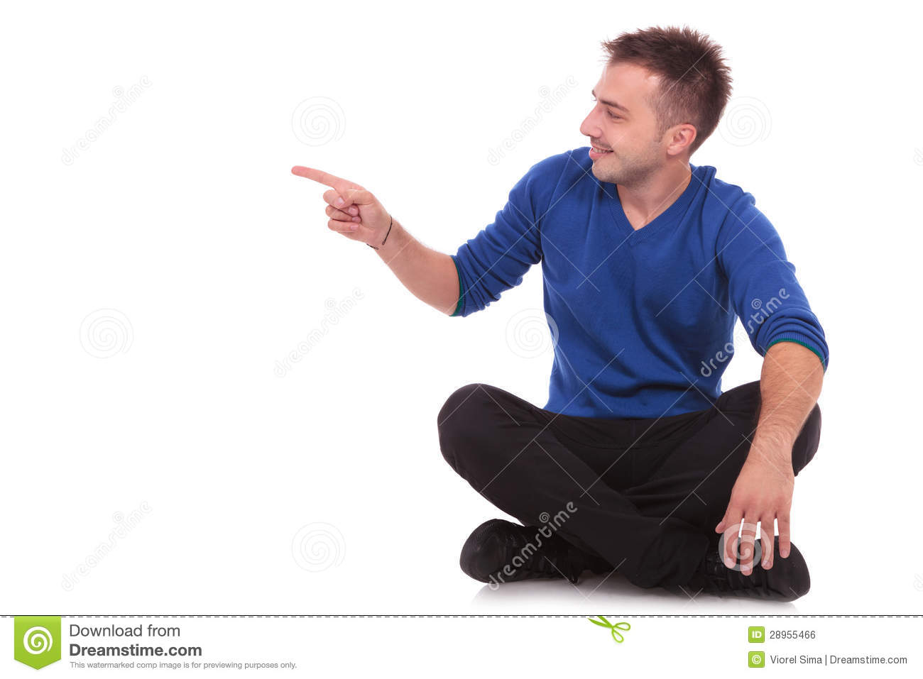 Man sitting on the floor and pointing to side stock photo for Floor someone
