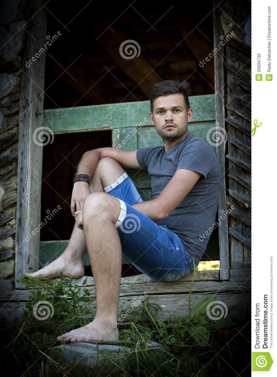 Man Sitting In Front Of Old Door Stock Photography Image
