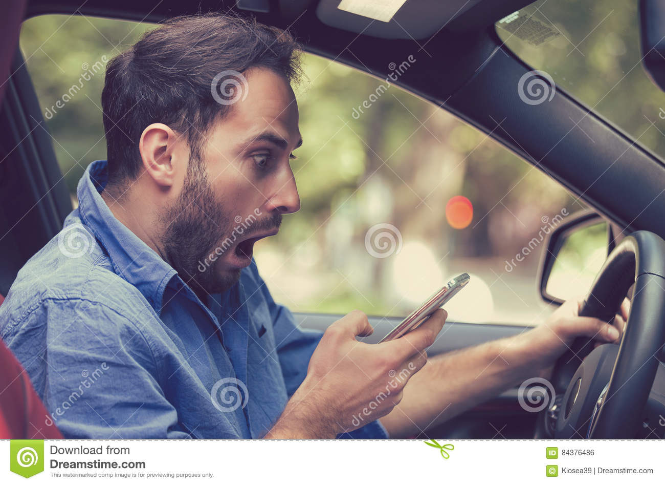 man sitting inside car with mobile phone texting while driving stock photo image 84376486. Black Bedroom Furniture Sets. Home Design Ideas