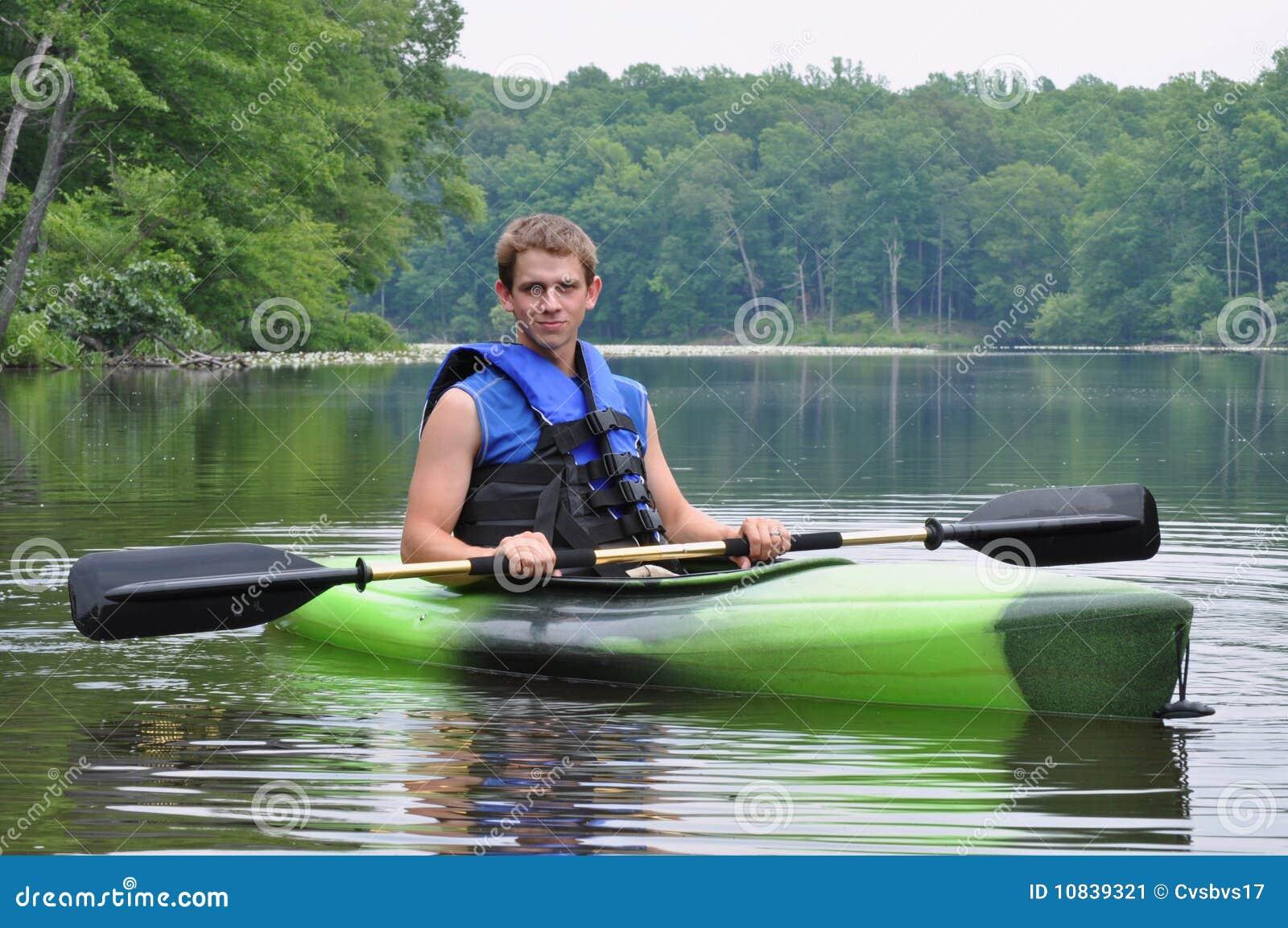 Man Sitting in Kayak stock image. Image of canoe, girl ...
