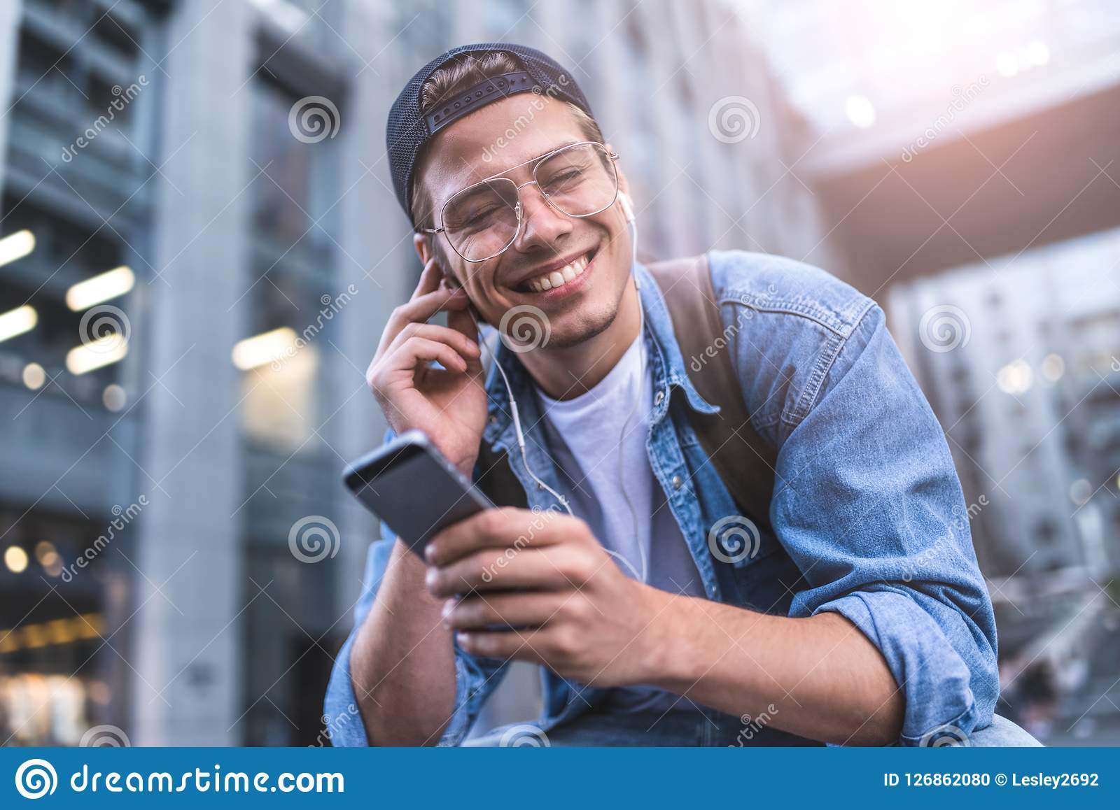 Happy Man Listening To Music With Headphones From A