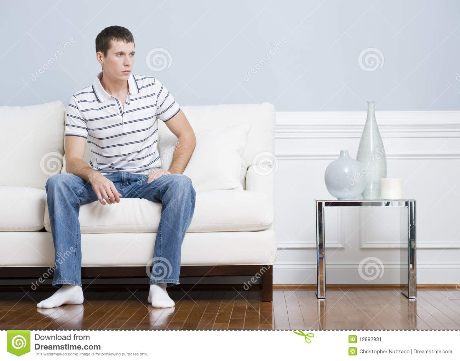 Man Sitting In Living Room