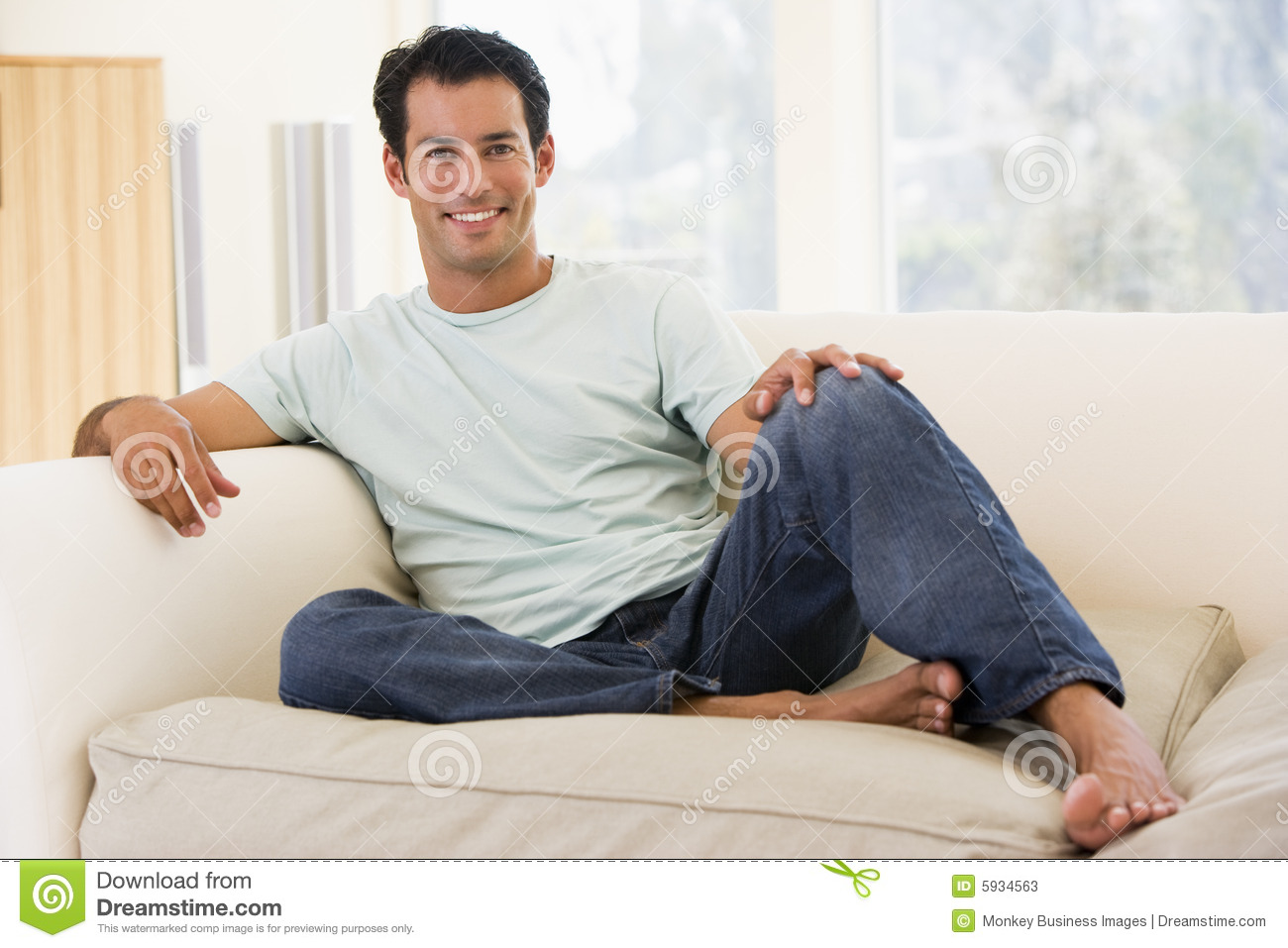 Man Sitting In Living Room Smiling Stock Photos Image 5934563