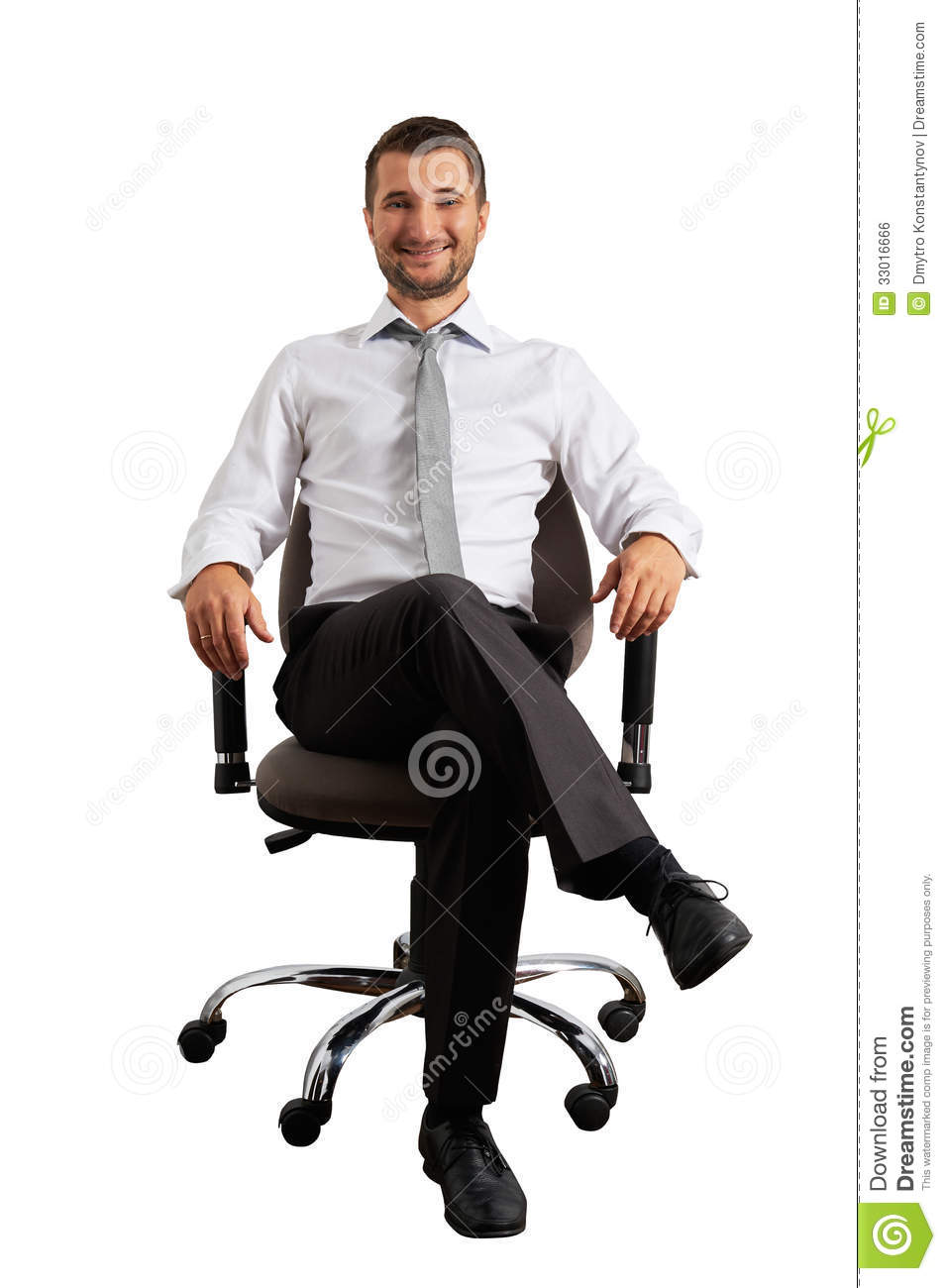 Man Sitting On Office Chair And Smiling Stock Photo
