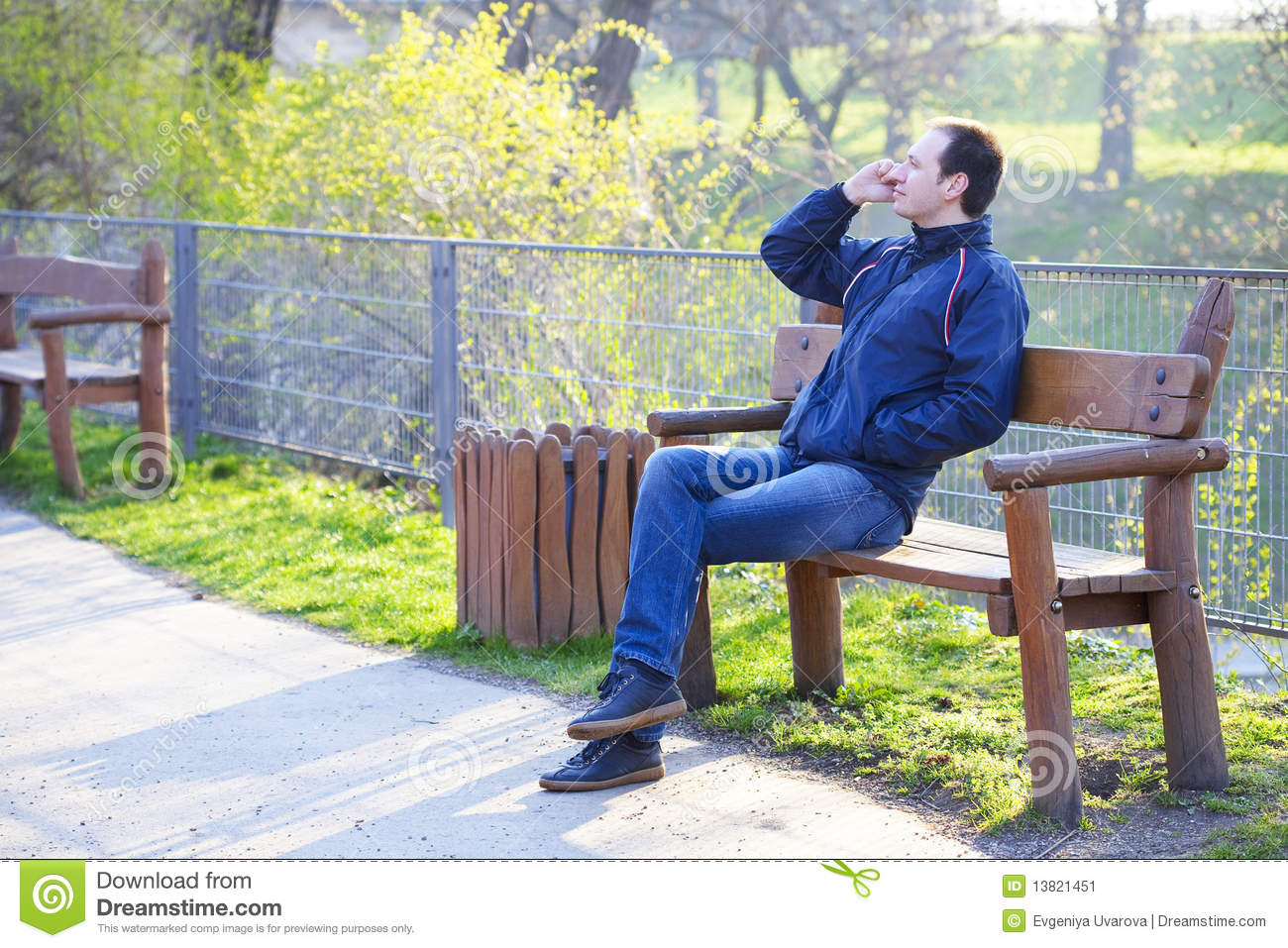 Man Sitting On A Park Bench Stock Image Image 13821451