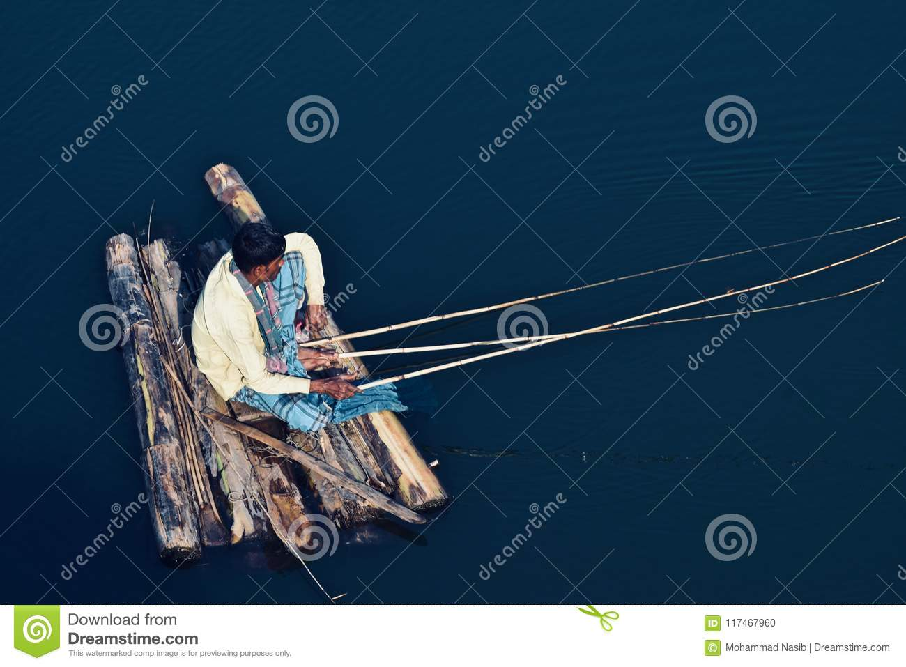 Download Man Sitting On A Place And Fishing In The Water Stock Photo - Image of weather, natural: 117467960