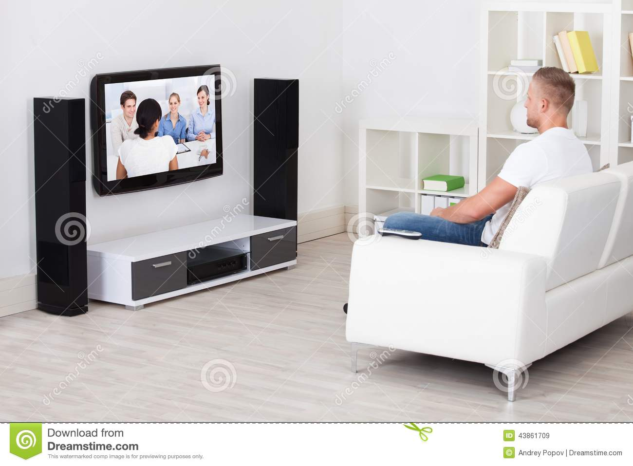 Handsome Man Sitting Down In Living Room