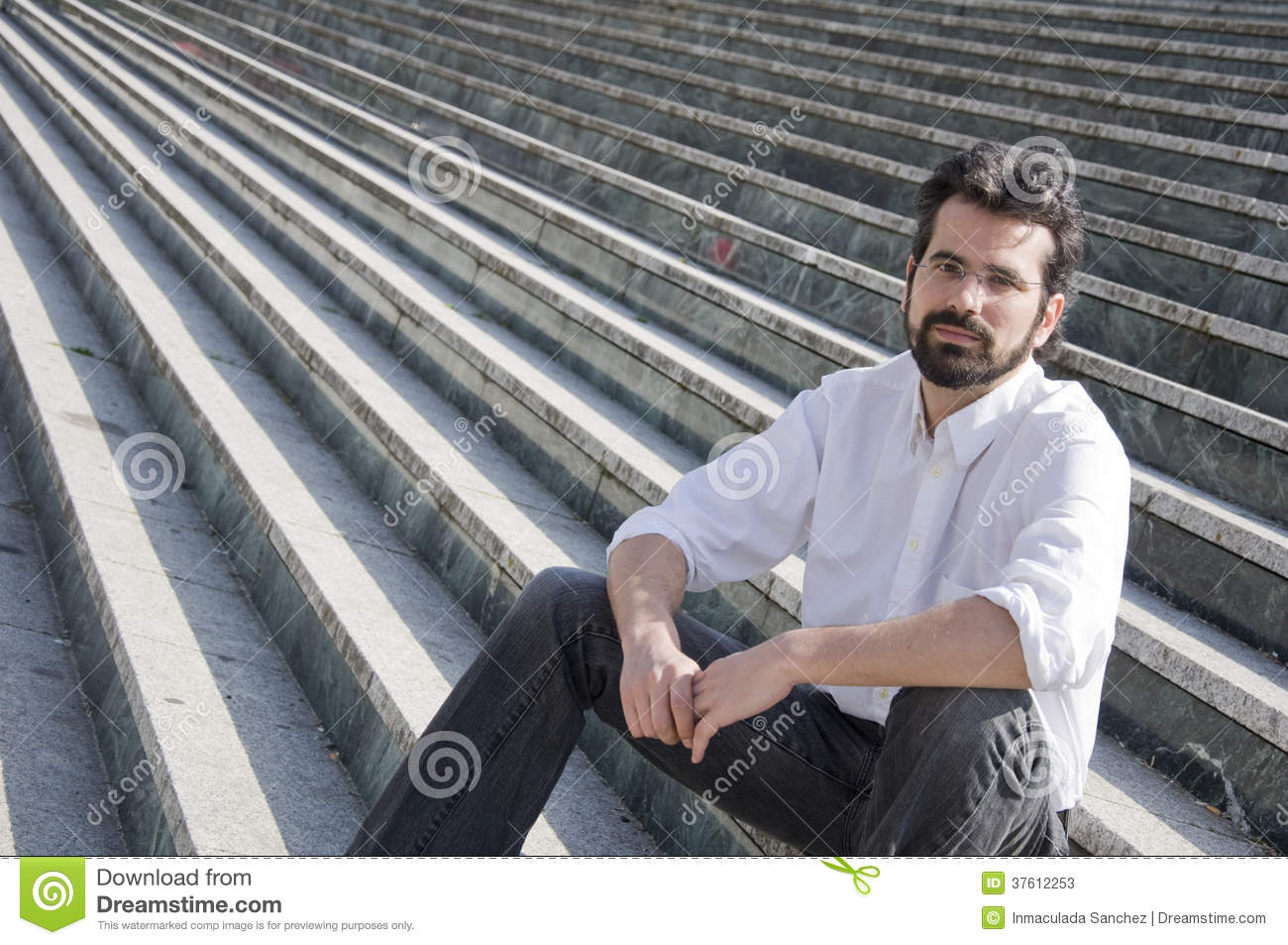 Man sitting in stairs