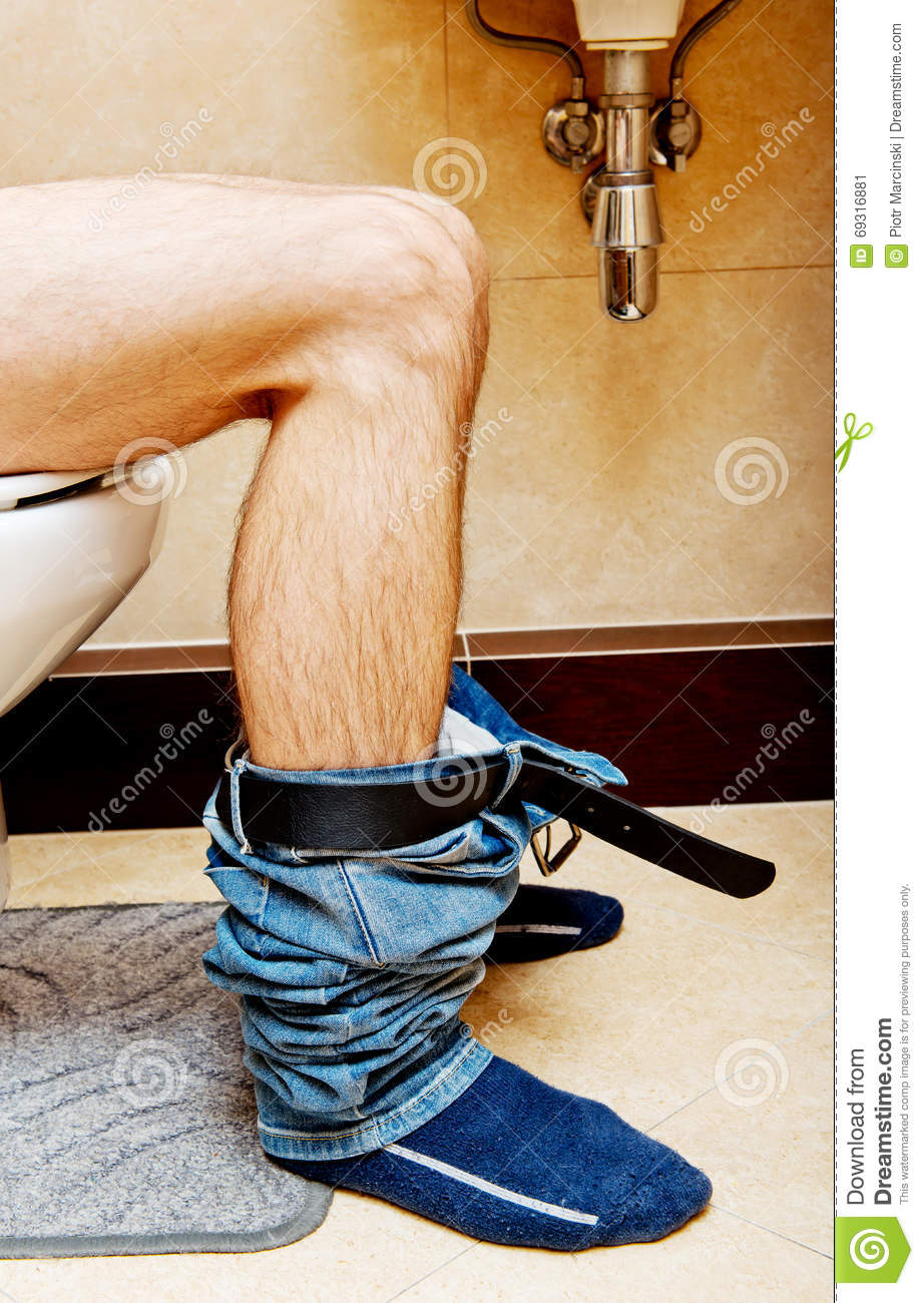Guys Sitting On The Toilet Stock Photos, Pictures