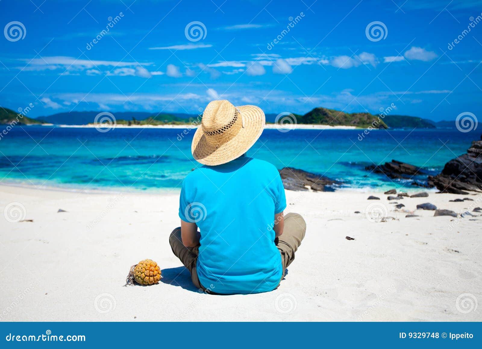 Man sitting on the tropical island beach
