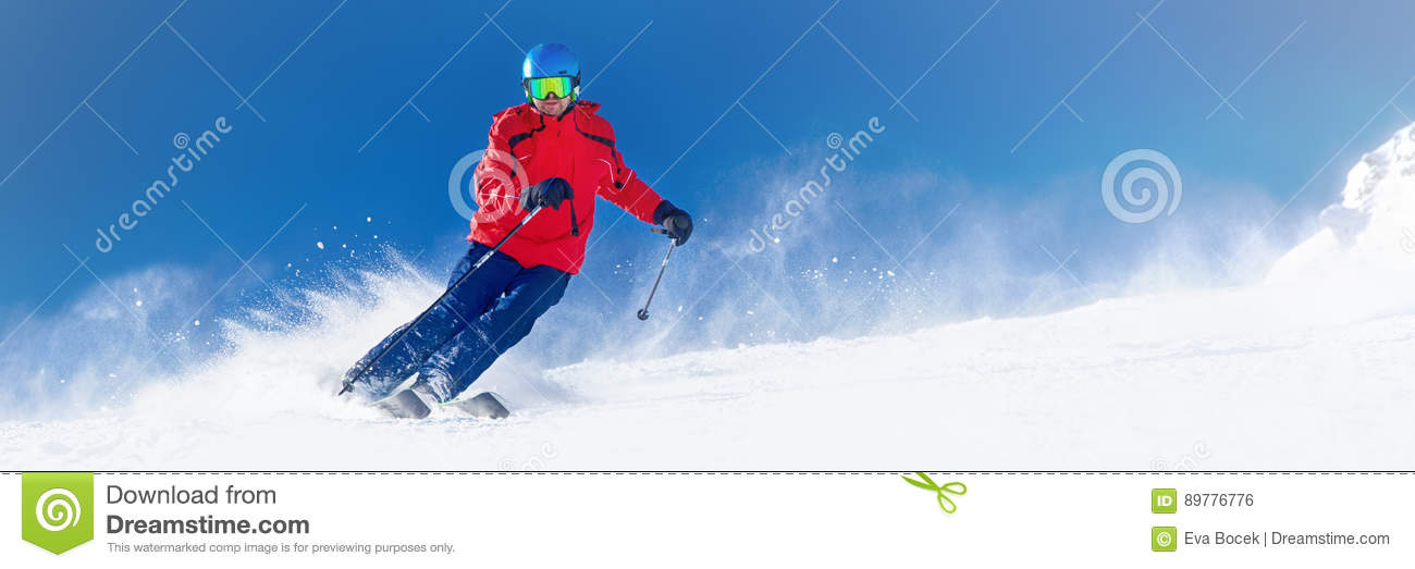 Man skiing on the prepared slope with fresh new powder snow in A