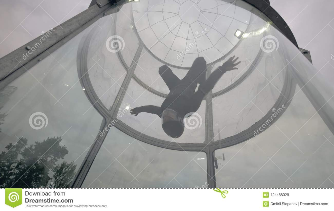 Man skydiver flies in wind tunnel. Flying in a wind tunnel. Extreme sports